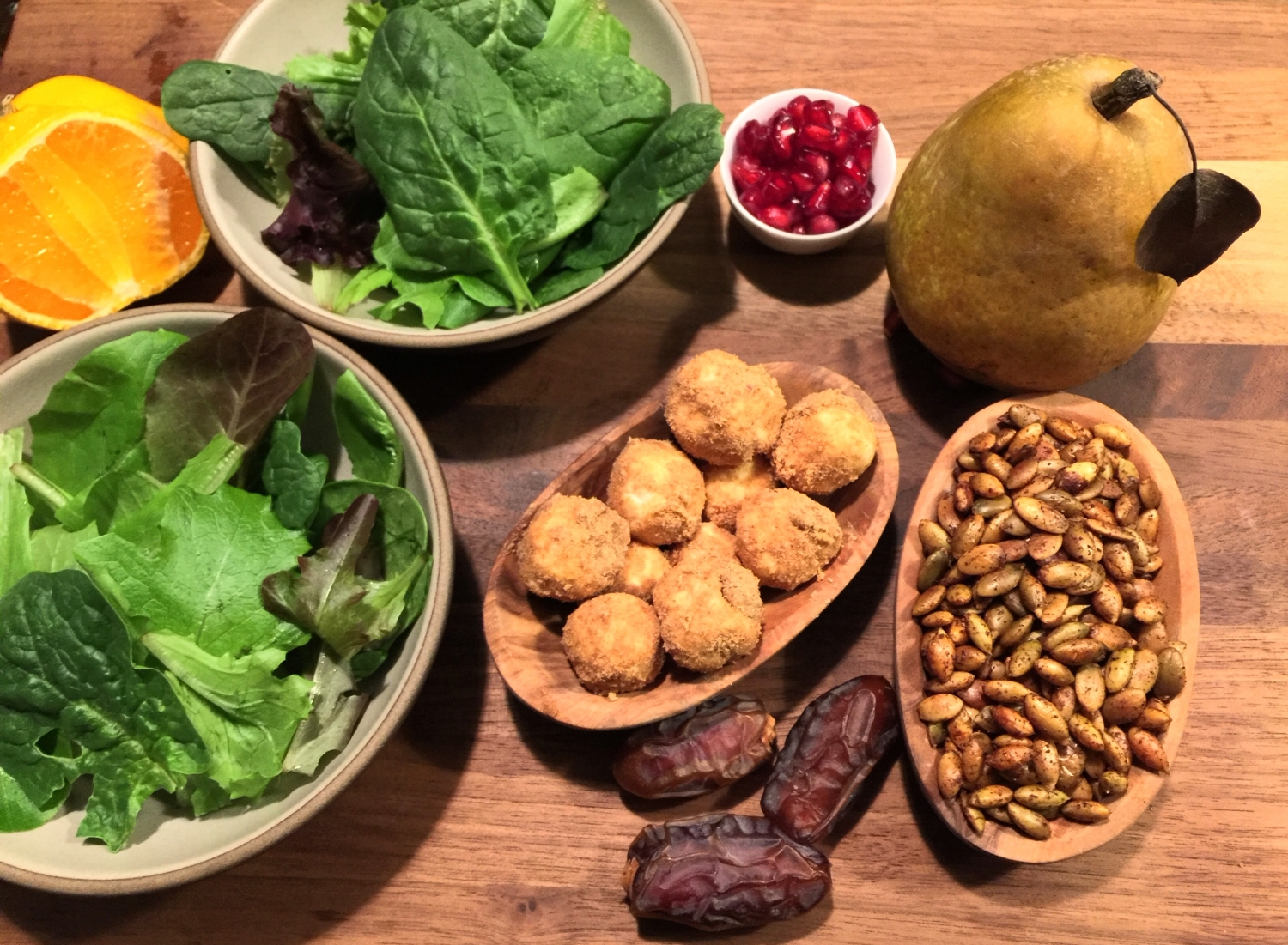 Autumn Pear Salad with Dates, Spiced Pumpkin Seeds, and Pumpkin Pita Goat Cheese Balls with Pumpkin Seed Oil & Mandarin Juice