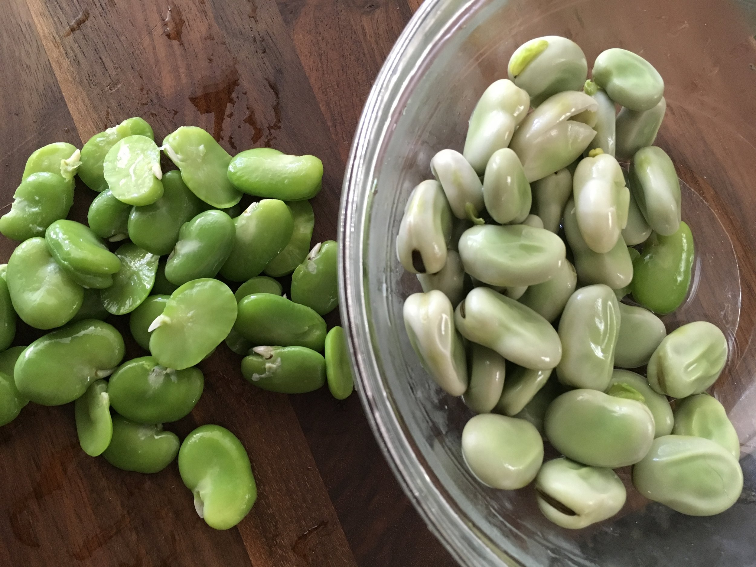 Fava beans (left) squeezed from shriveled shells (right) after a 2 minute blanch & ice bath