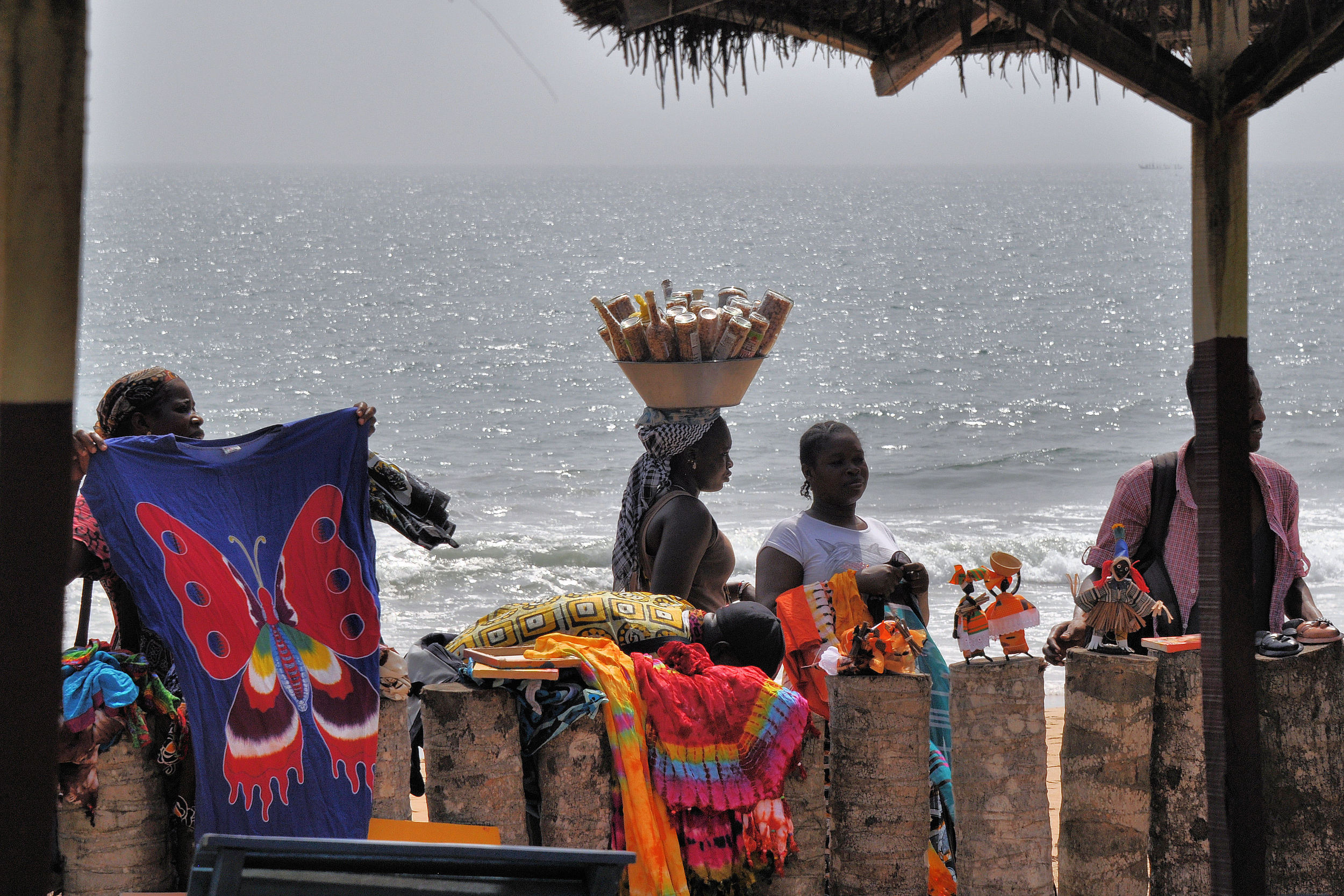 Vendors selling souvenirs to guests at a beach front hotel in Grand Bassam, Ivory Coast