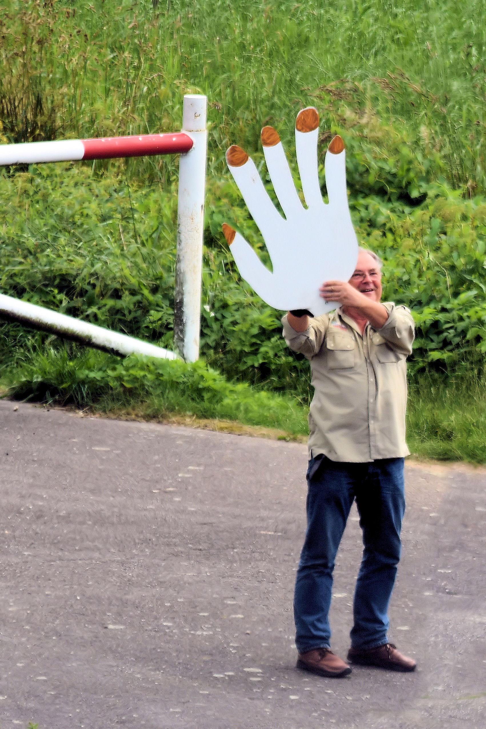 Prepared for an afternoon at the busy Kiel Canal, this friendly man cut out a giant hand for a more effective and noticeable wave.
