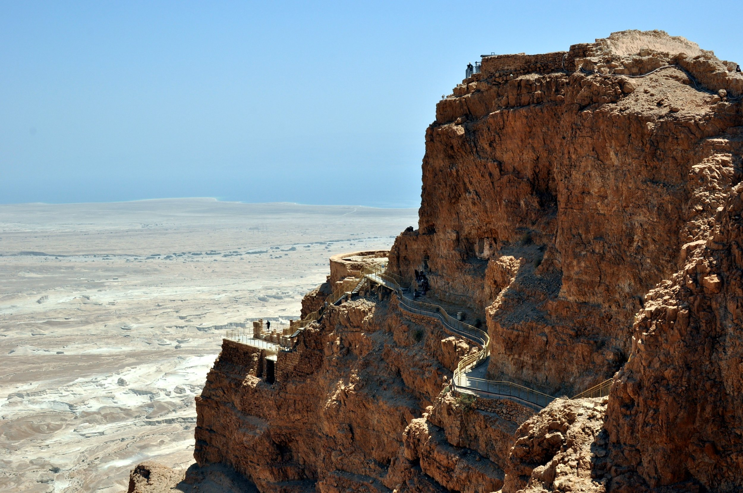 The three rock terraces of the Northern Palace, Masada. The Dead Sea is in the background.