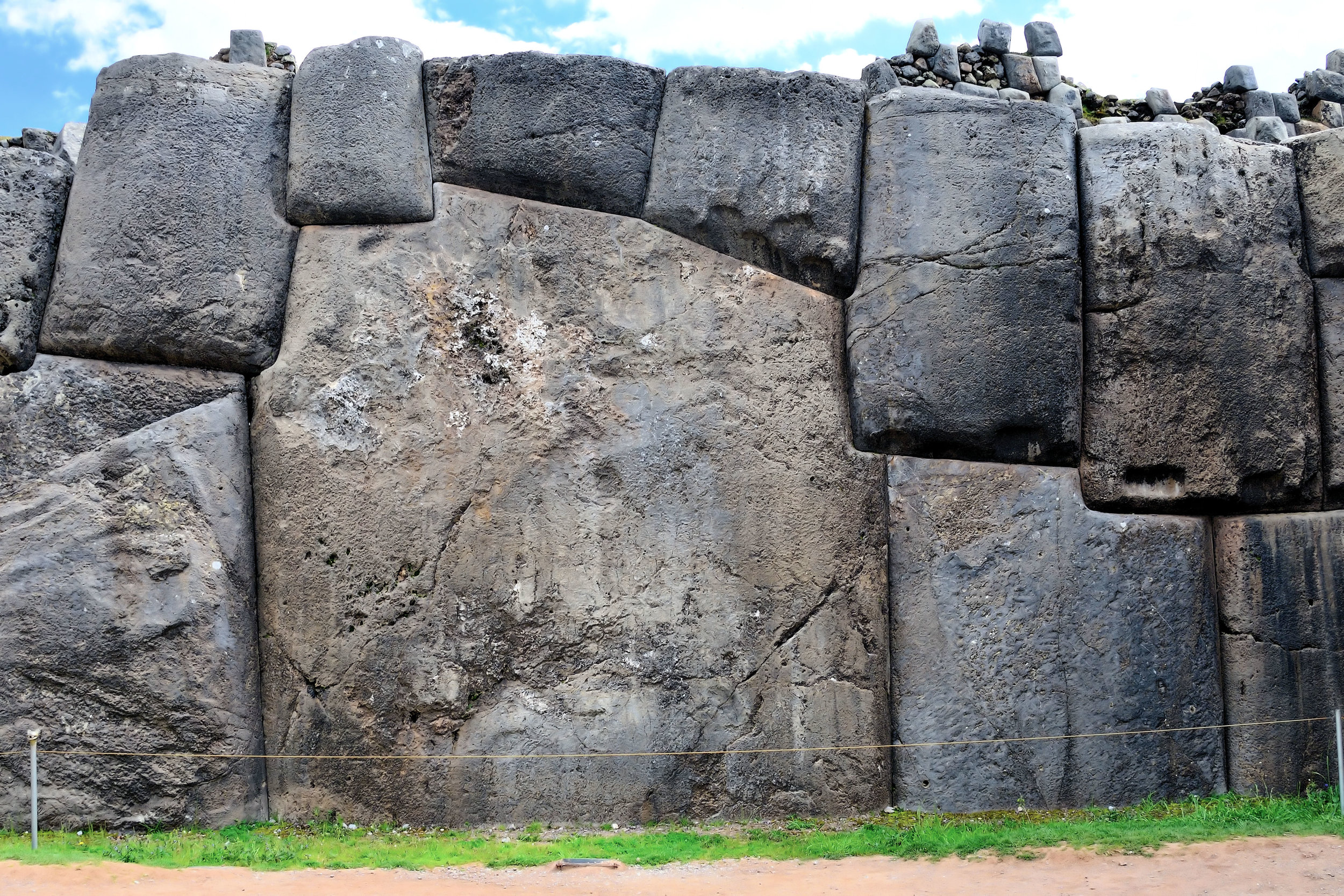 This wall represents the remnants of an Incan temple just outside of Cusco. Look at the large stone in the middle. It weighs 120 metric tons. It was moved to this site from a quarry 1 mile away. The Incas did not use wheels during the transport of building materials. Why not use smaller pieces of granite? Why the tremendous effort to move such a large stone?