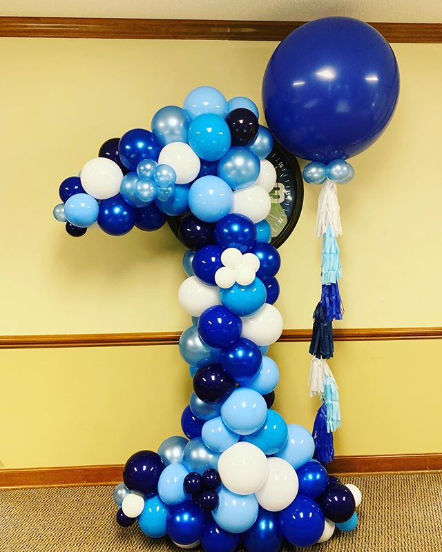 Happy First Birthday Chadwick!  We had the pleasure of making this organic number 1 sculpture with a large 3 footer with tassels for a special boy.  #balloons #balloondecor #organicballoondecor #1stbirthday #birthdayparty #babyboy #shadesofblue #ncevents #eventplanner #raleighnc #ncballoons #jujabel