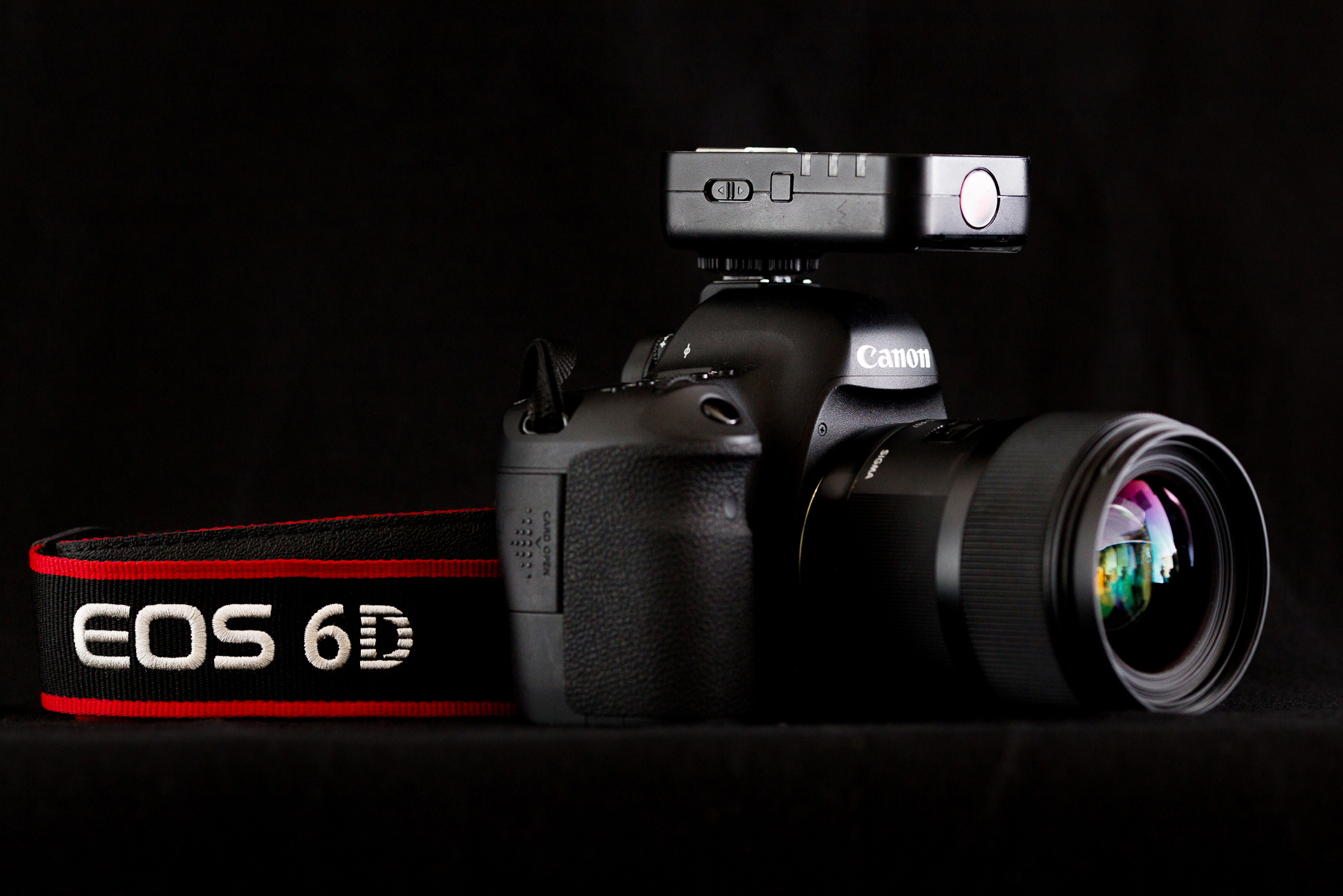 Here's my 6D paired with my Sigma Art 35mm 1.4 and a Yongnuo Yn622c trigger. This is what I use for my BTS photos.
