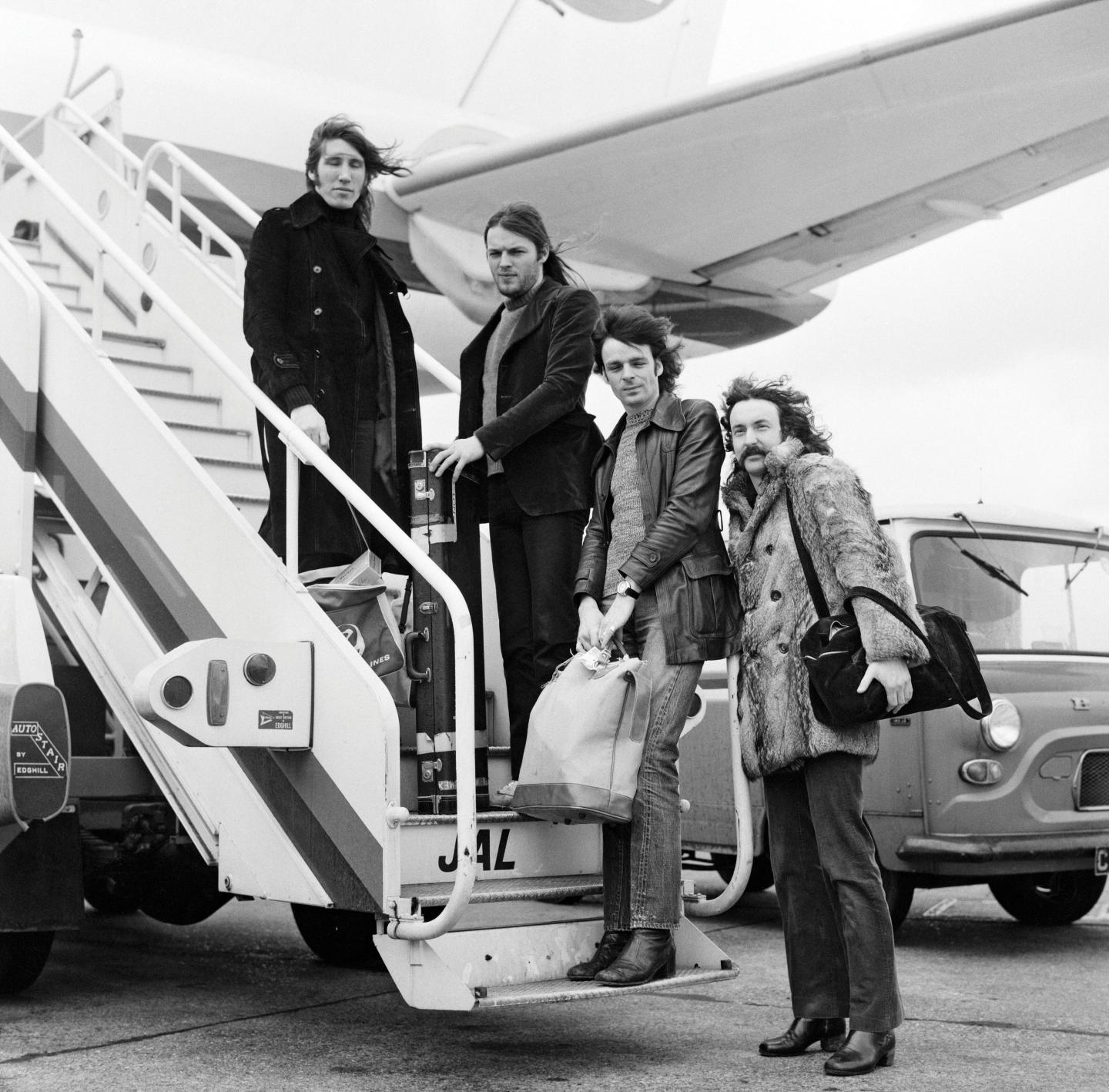 PHOTO:  The band prepares to board a DC-8 jet airliner for a 12-day tour in Japan, on March 3, 1972. They had all of the plane's 114 seats to themeslves . - Newsweek