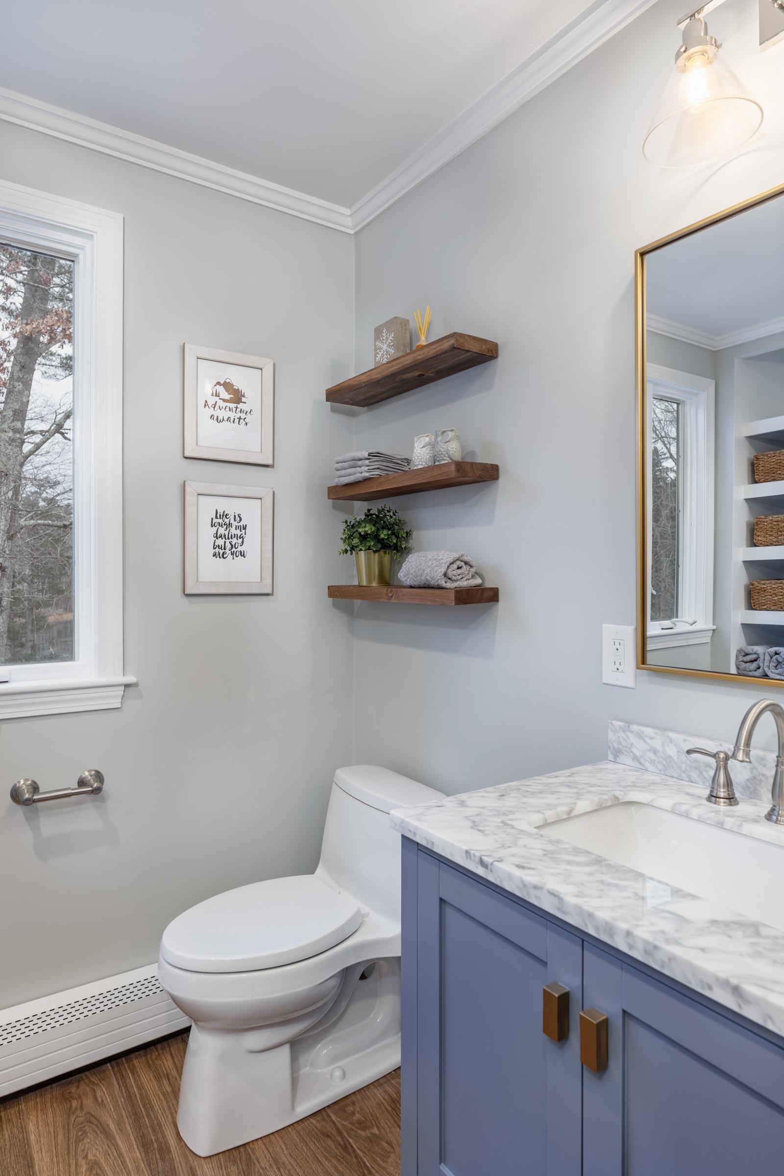Vanity toilet shelves and built-in reflection.jpg