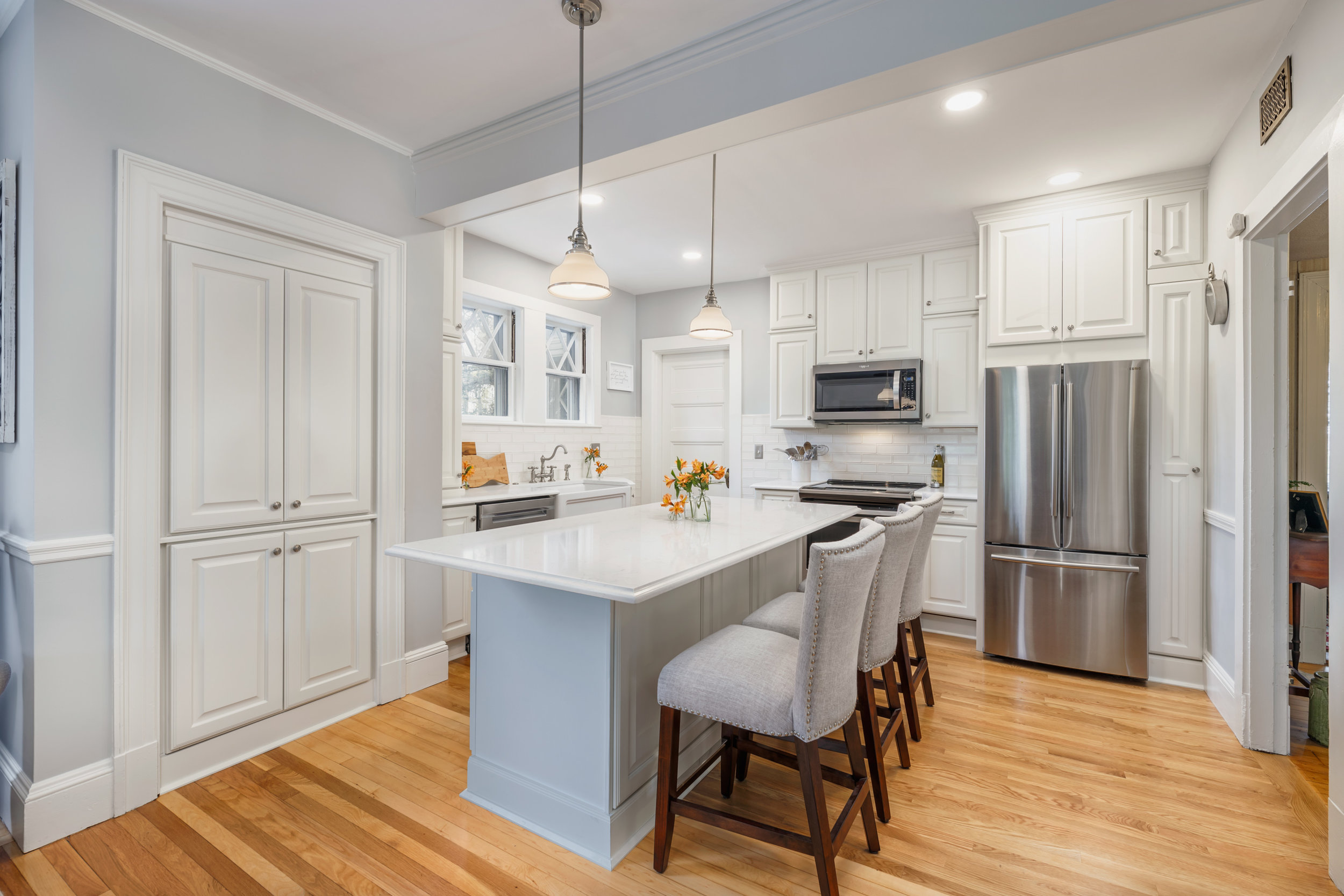 Complete kitchen - Angled looking toward island and fridge.jpg