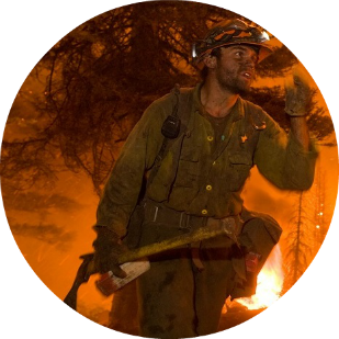 Firefighter in wildfire, by USDA, cc. C2.png