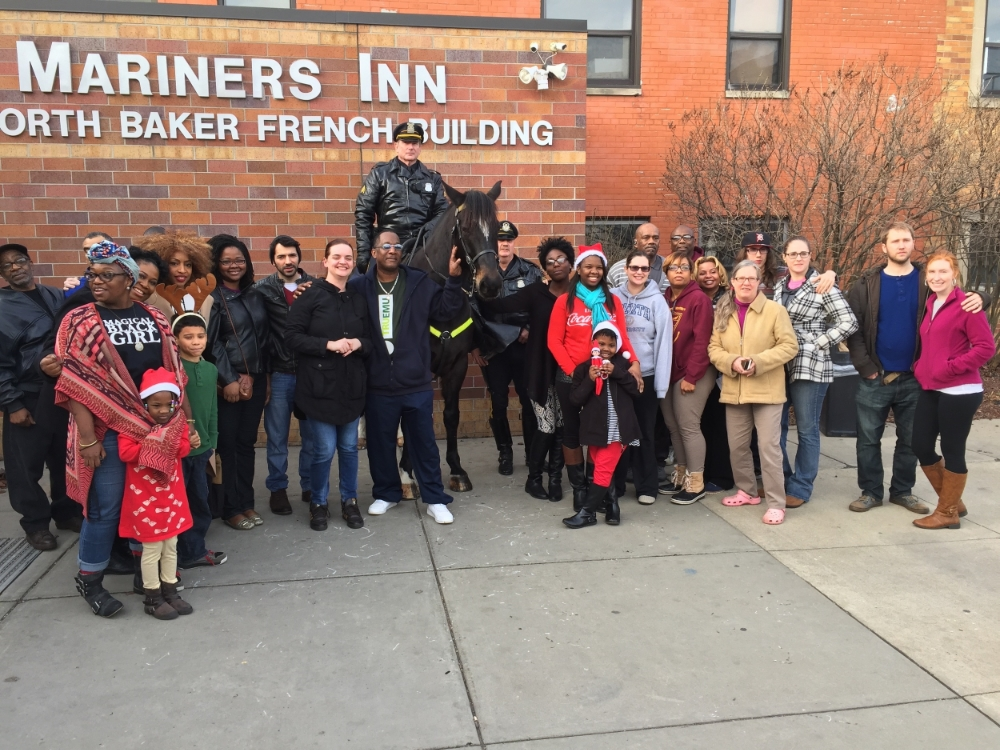 The staff of Mariners Inn, some of the volunteers, and two of Detroit's finest - Christmas Day, 2015