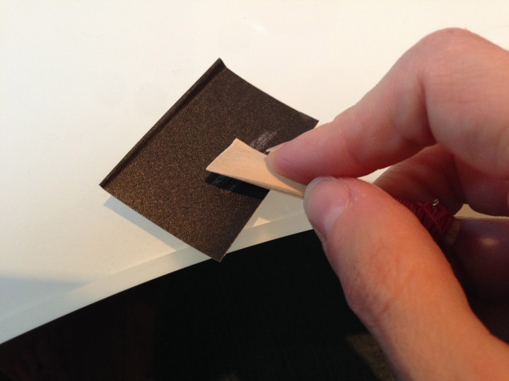 Sanding the right quadrant of the tip