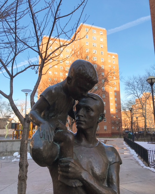 This Richmond Barthe sculpture near the Johnson Houses contrasts the image of intended residents (white families) with the current racially diverse demographics of NYCHA residents, which is part of why support for public housing has vanished. That must change. (homebodynetwork)