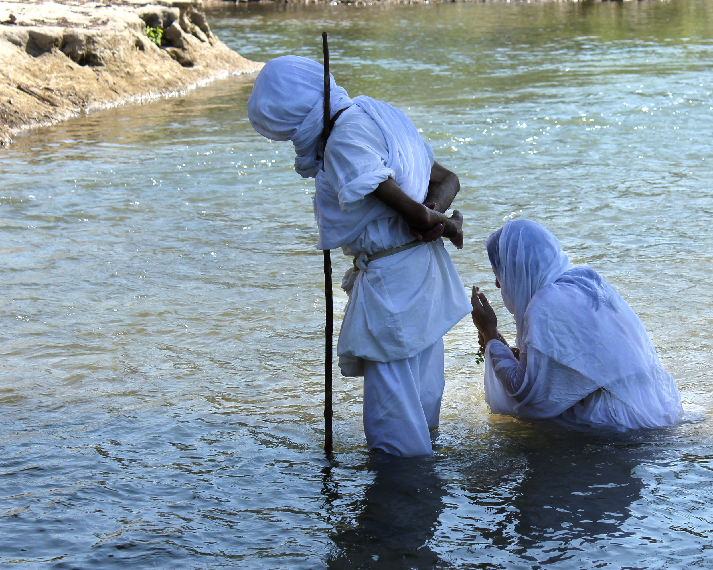 Azita Ebad is baptized. The Mandaeans believe they can only perform their baptisms in living water, like a river or spring. In addition to the Guadalupe River, they sometimes perform their ceremonies at Barton Springs, a popular natural swimming pool, in Austin, TX.