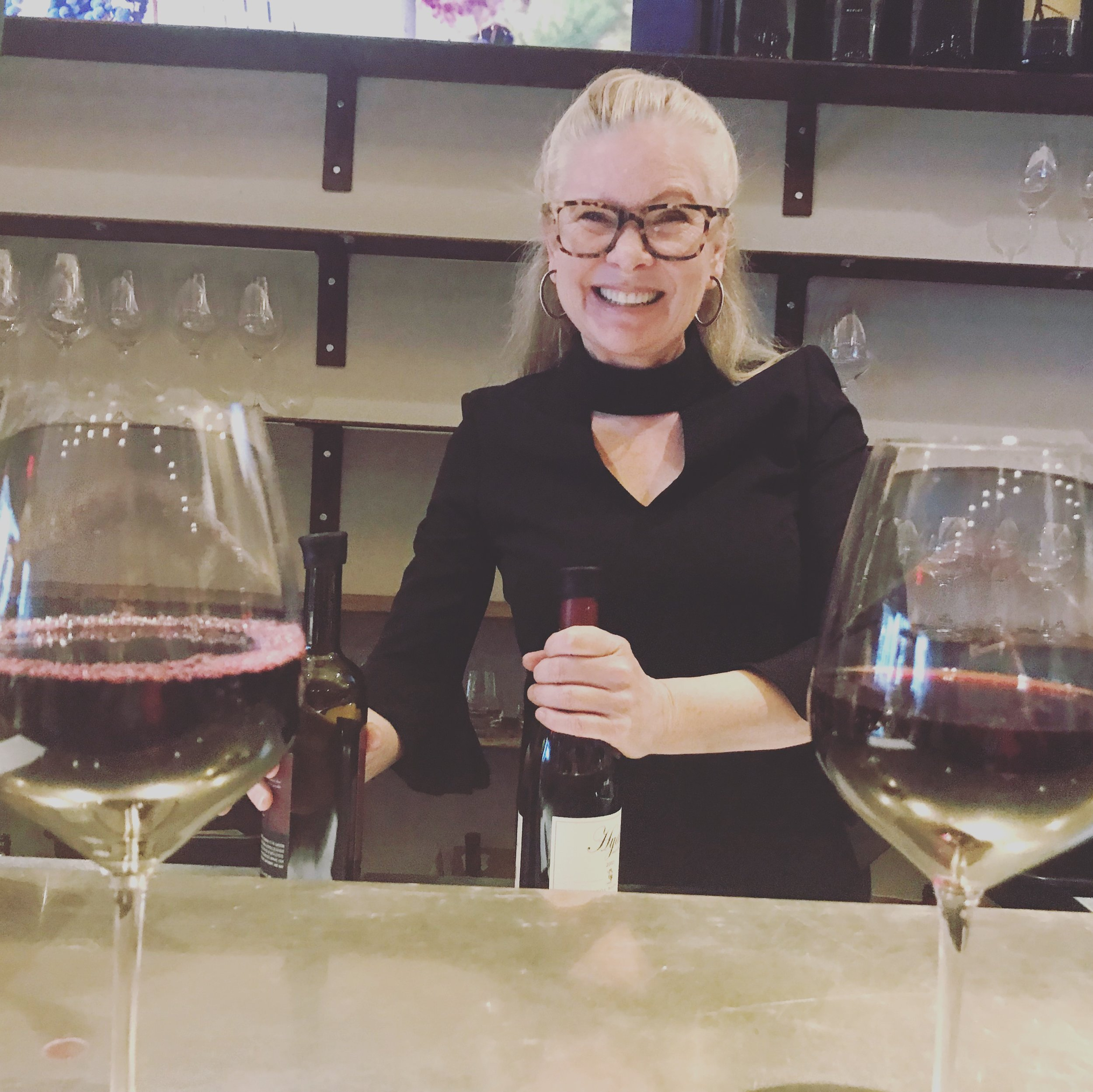 Hi, I'm Layne - This photo is of me guest-bartending at my favorite wine bar (I also am an investor) February 18, 2019. I had a blast!