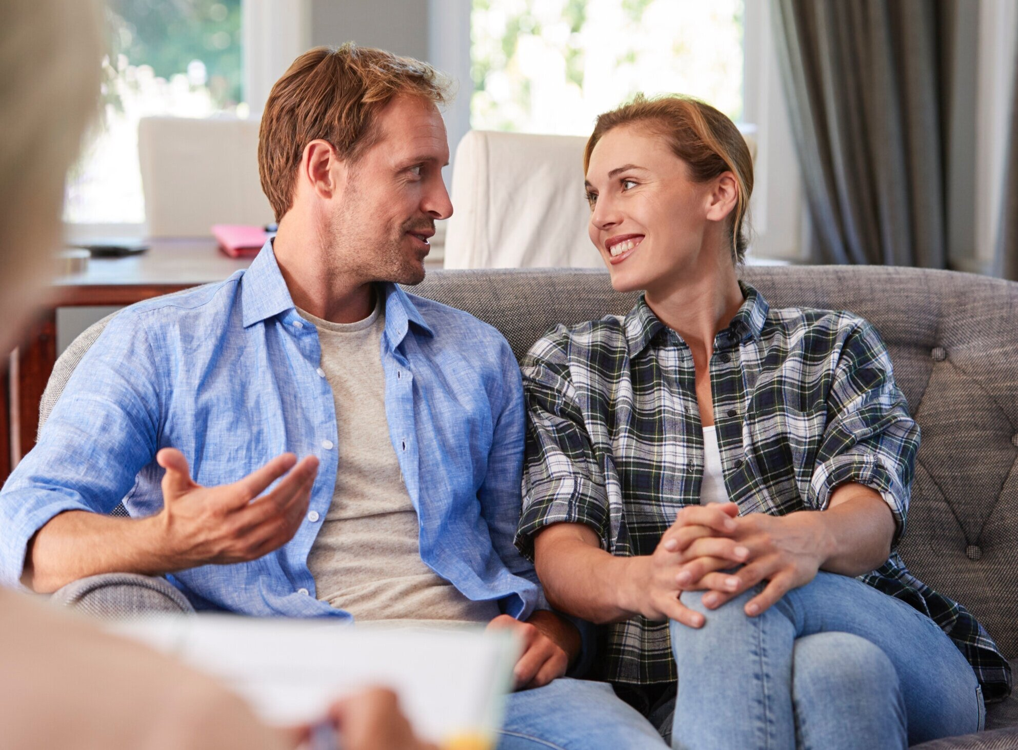 happy-young-couple-taking-financial-advice-at-ENB8964.jpg