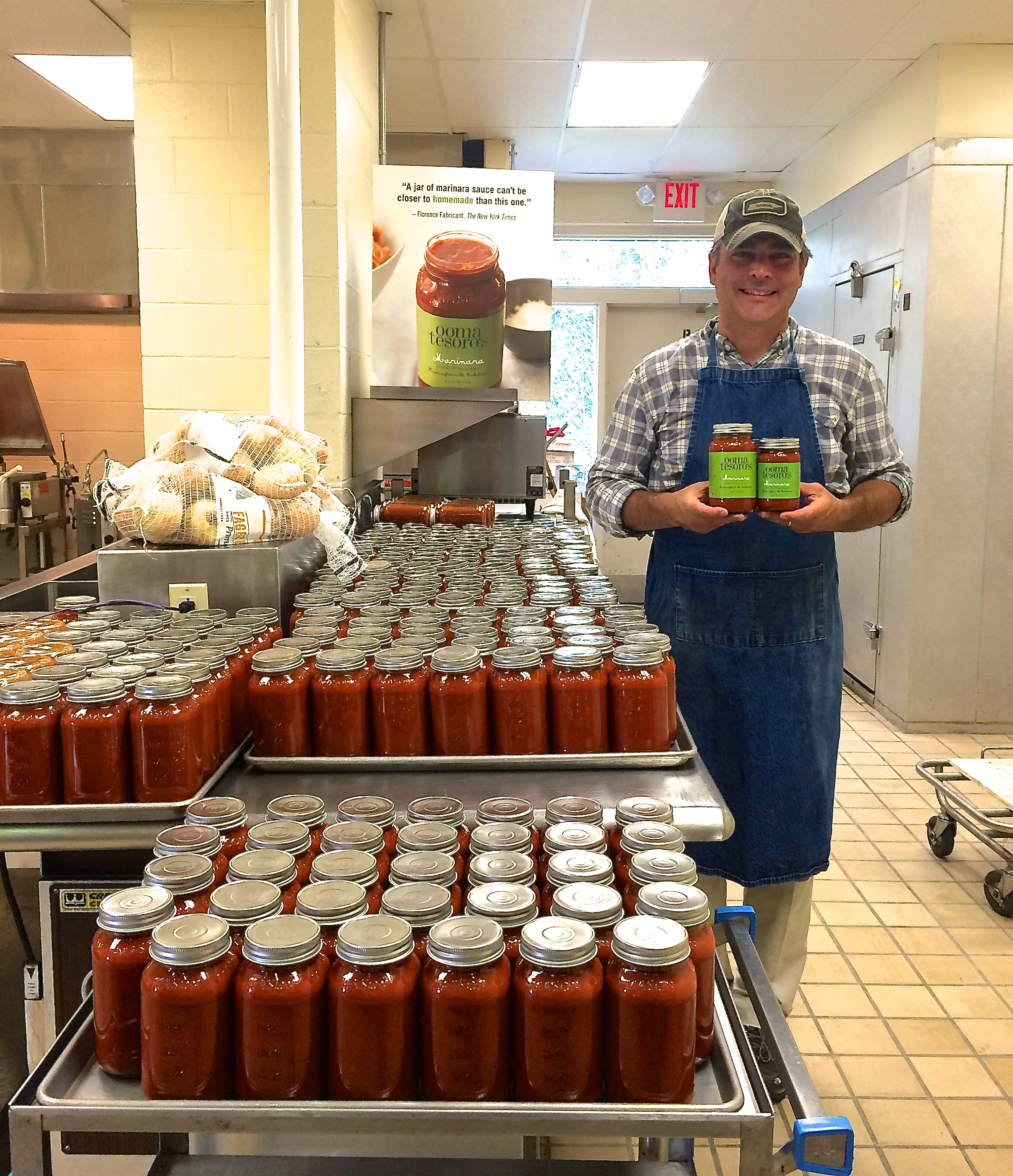 We make all our batches by hand! Really and truly HANDCRAFTED. Here is a photo of Michael at our kitchen after jarring a batch of sauce.