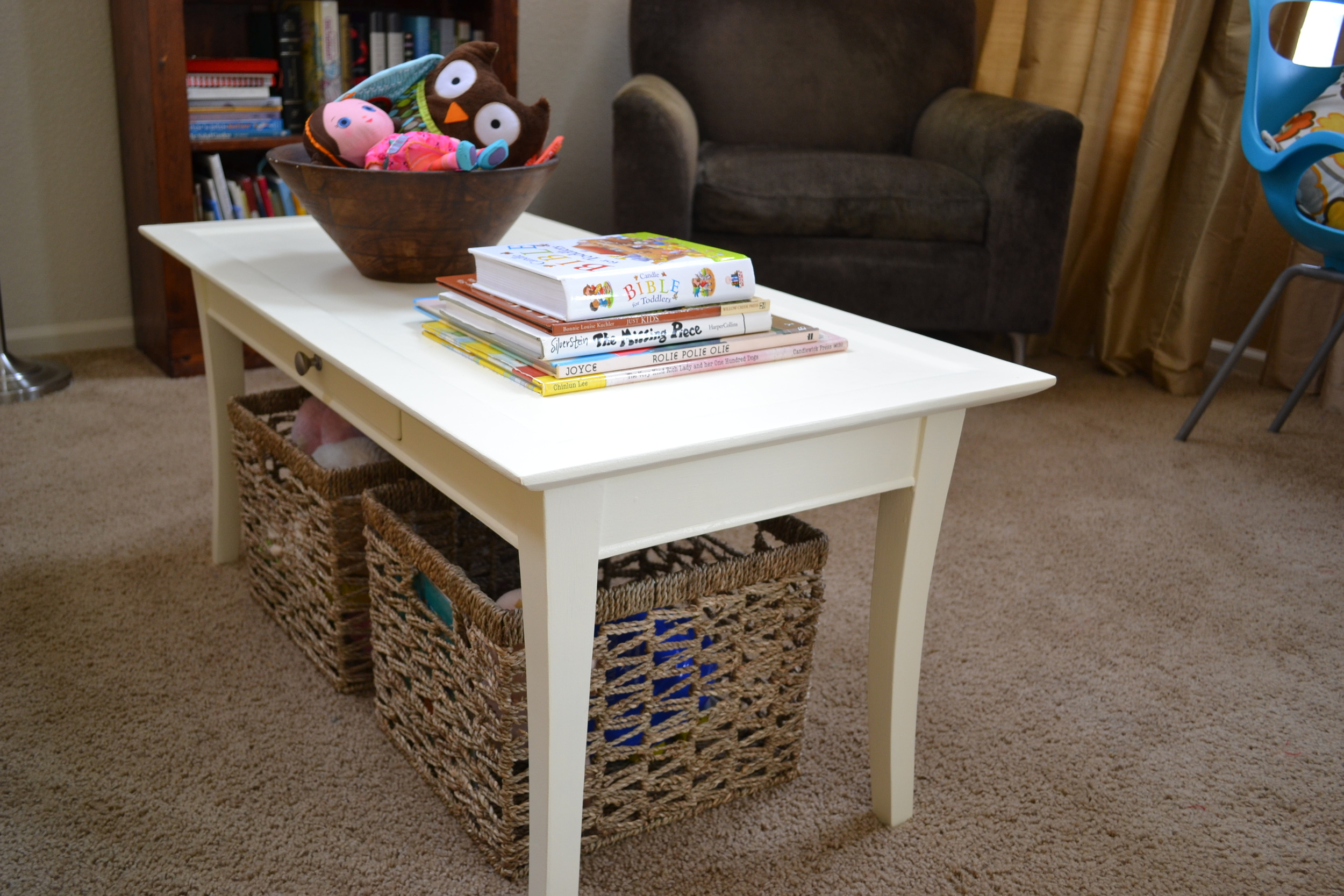 A wooden coffee table painted with Valspar Jekyll Club Veranda in Ivory