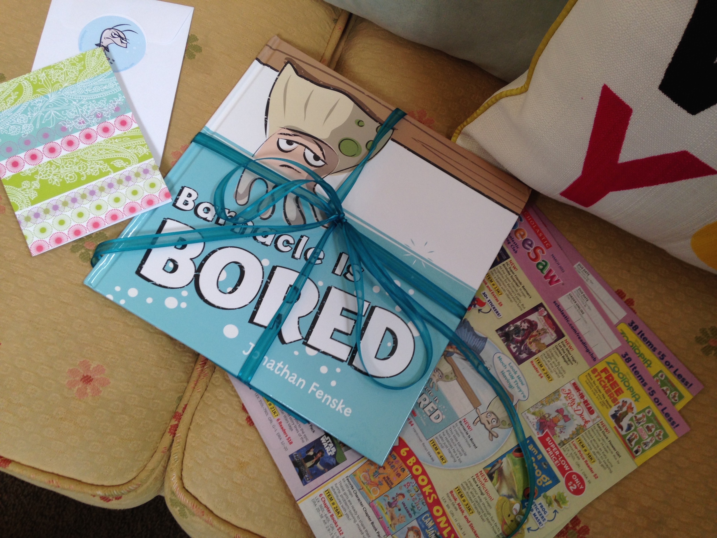 My editor at Scholastic, Katie Carella, sent me this fun package. We'd like to send you fun goodies in the mail, too! We're mailing buttons, postcards and softcover books.