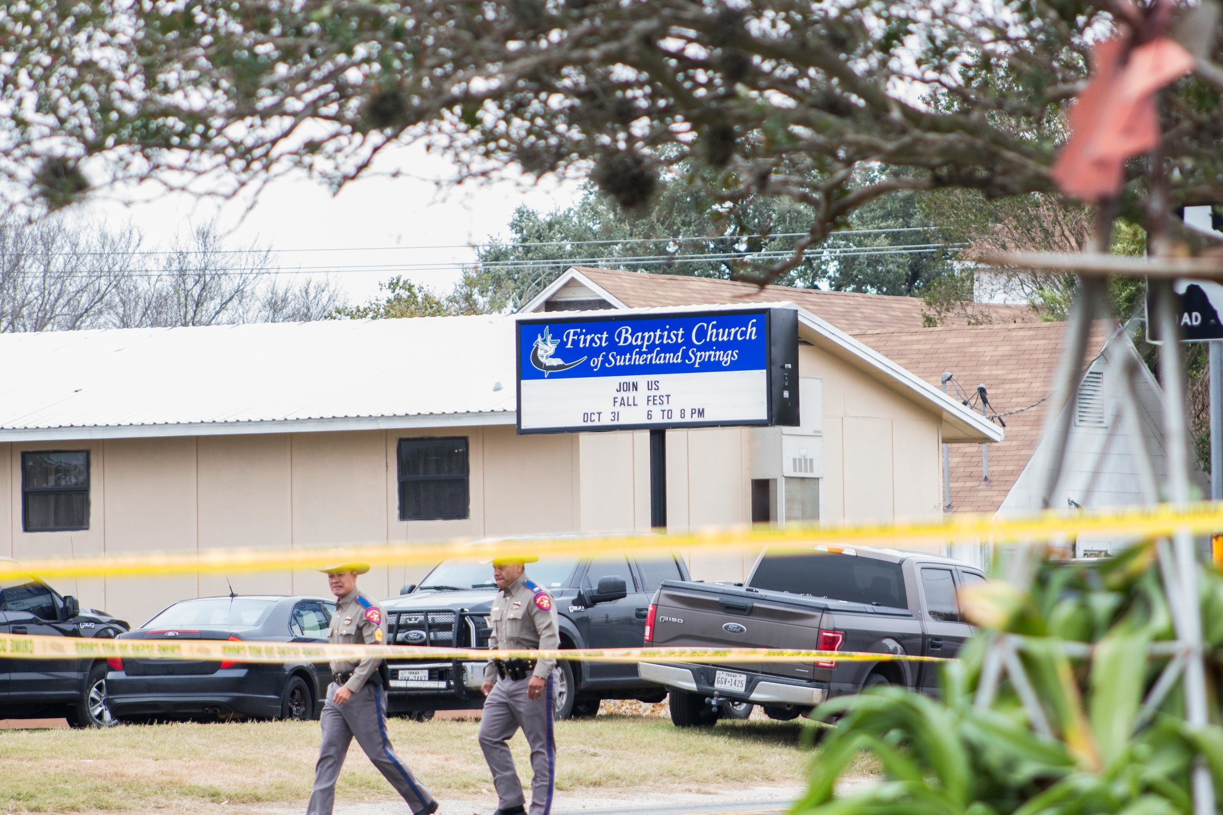 Law enforcement walk in front of the First Baptist Church of Sutherland Springs in the aftermath of the shooting on Nov. 8, 2017.