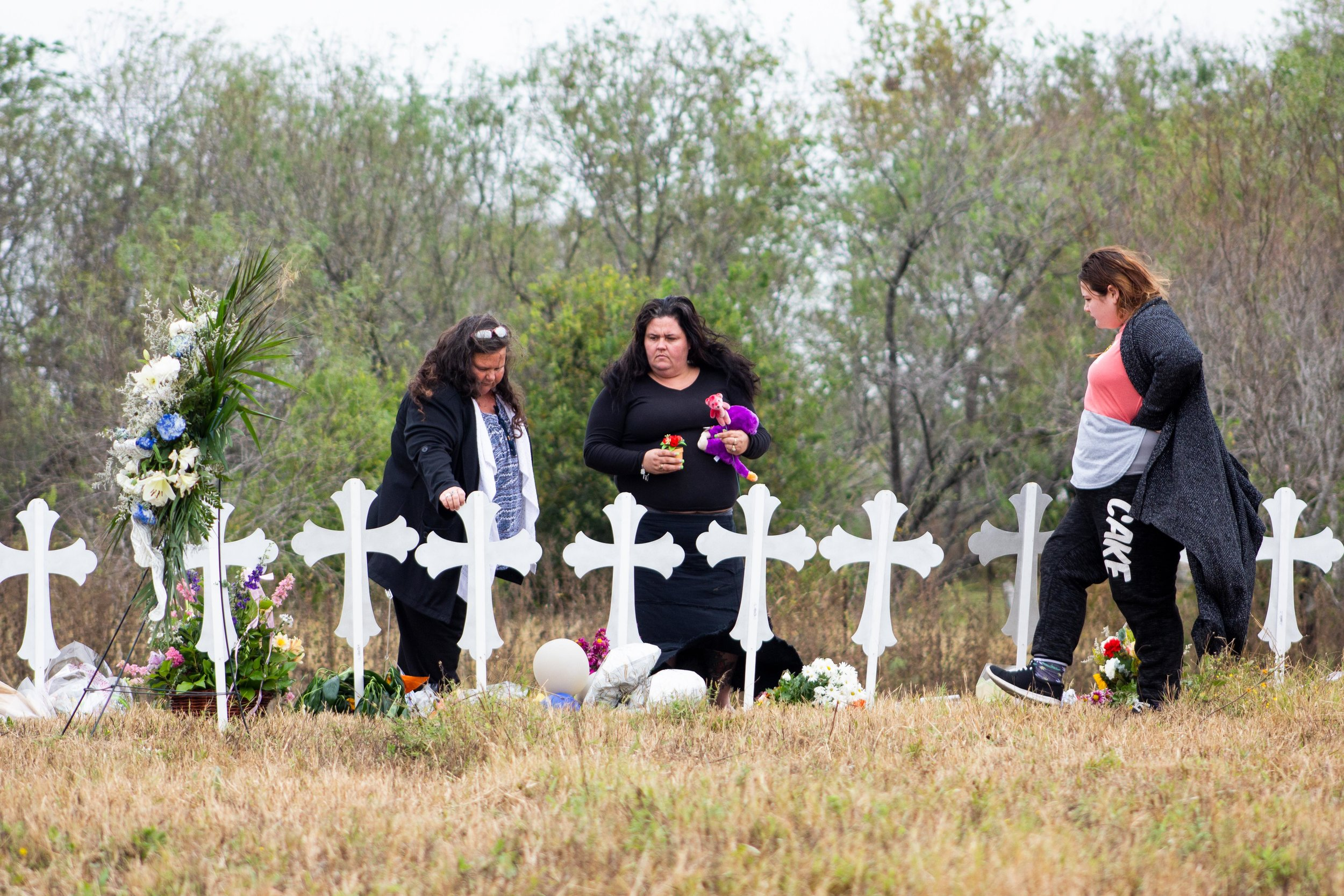 Alison Gould (right) visits a site of 26 metal crosses with her mother Jodi Gould (middle). The crosses represent the 26 people killed at the First Baptist Church of Sutherland Springs when a gunman opened fire on Nov. 5, 2017.