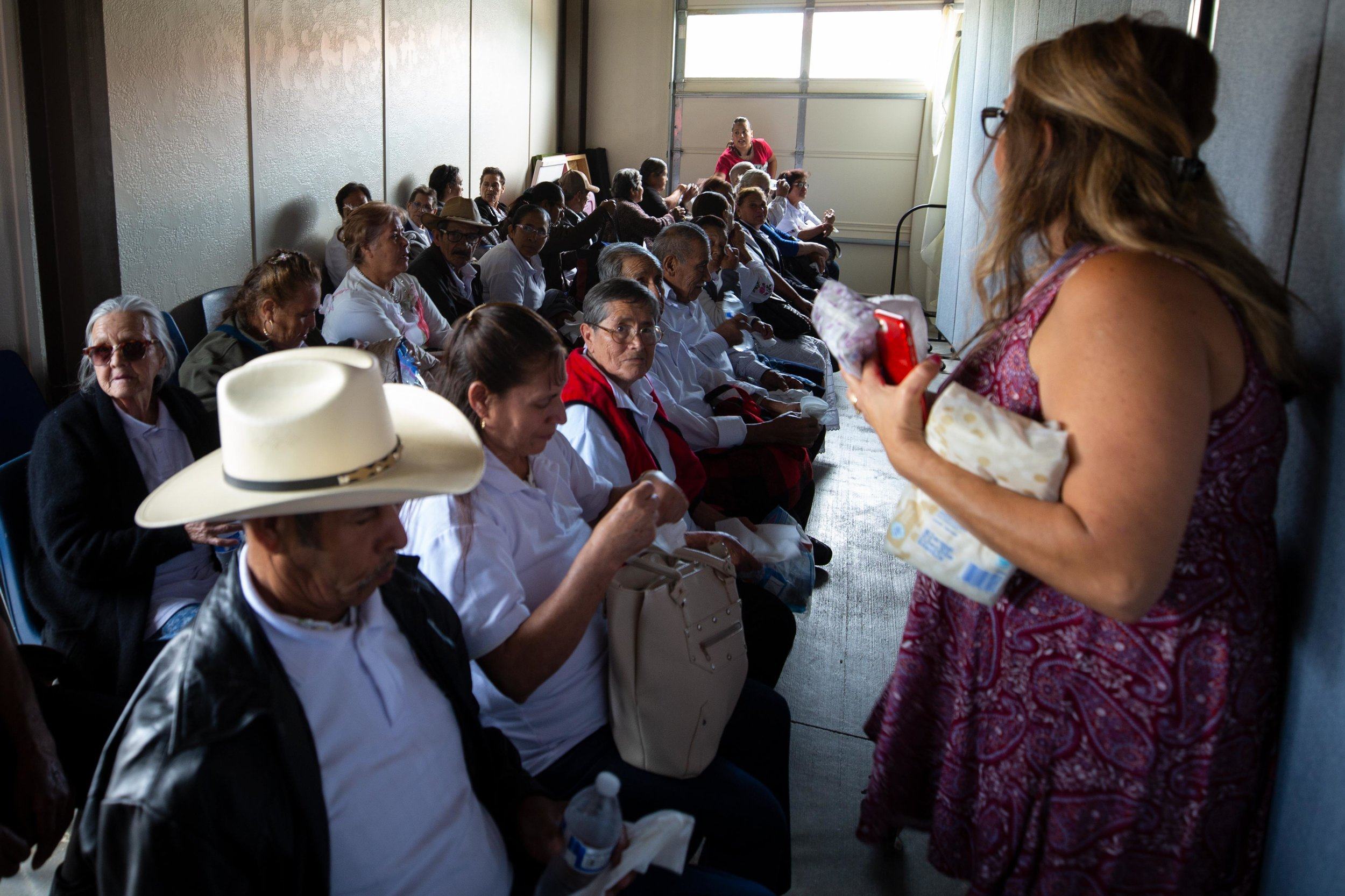 ROUND ROCK, TX. August 10, 2018. Mexican parents wait to be reunited with their children, whom they have not seen in more than a decade. The Consulate General of Mexico in Austin and the government of the State of Michoacán assisted parents with applying for tourist visas that will last ten years. A program called Palomas Mensajeras (homing pigeons) came to the Austin area to reunite the families. Montinique Monroe for KUT News
