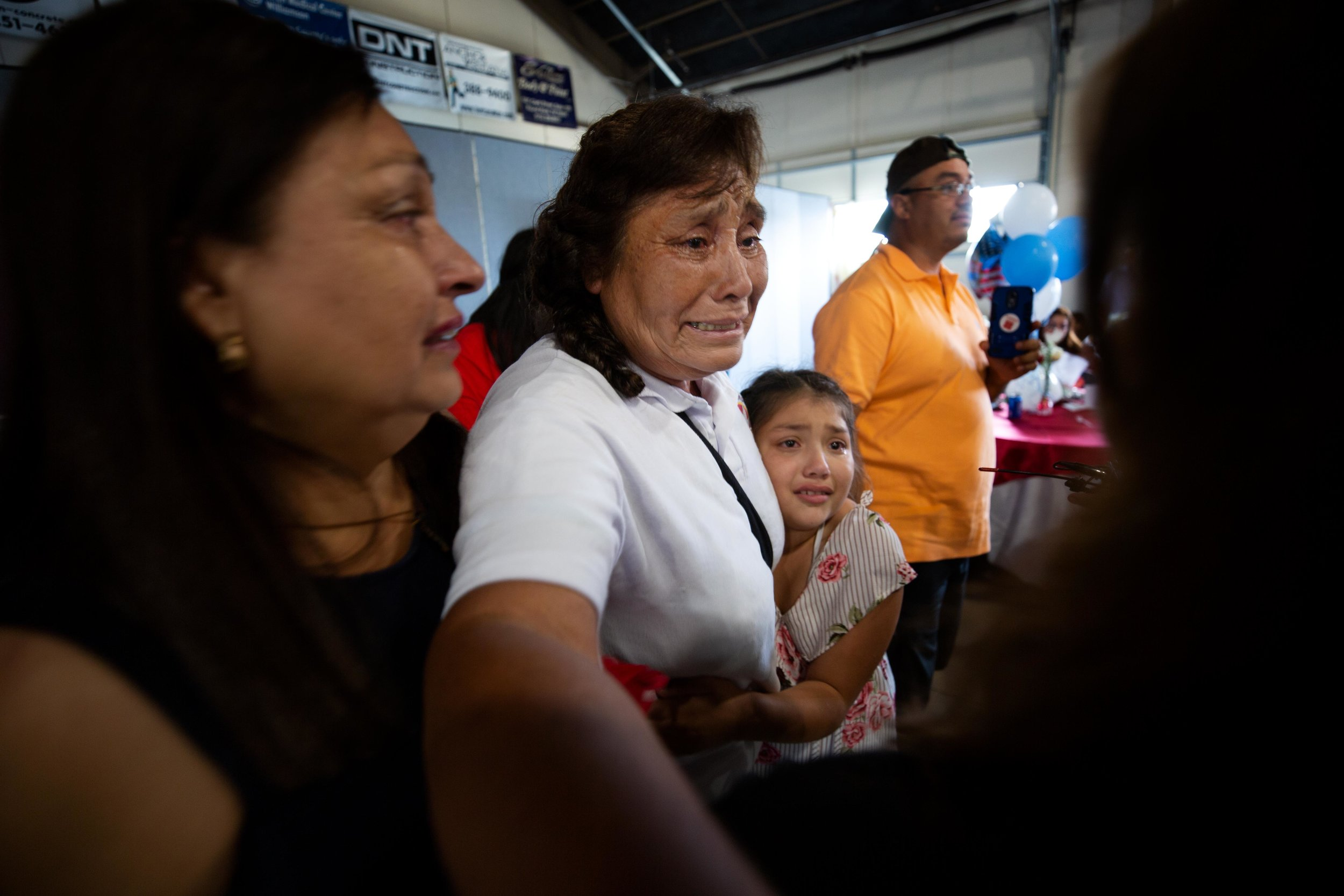 ROUND ROCK, TX. August 10, 2018. Rosa Barriga Barriga embraces her family during a family reunification event hosted by a program called Palomas Mensajeras (homing pigeons). Barriga traveled from the Mexican State of Michoacán to be reunited with family members she has not seen in over a decade. Montinique Monroe for KUT News