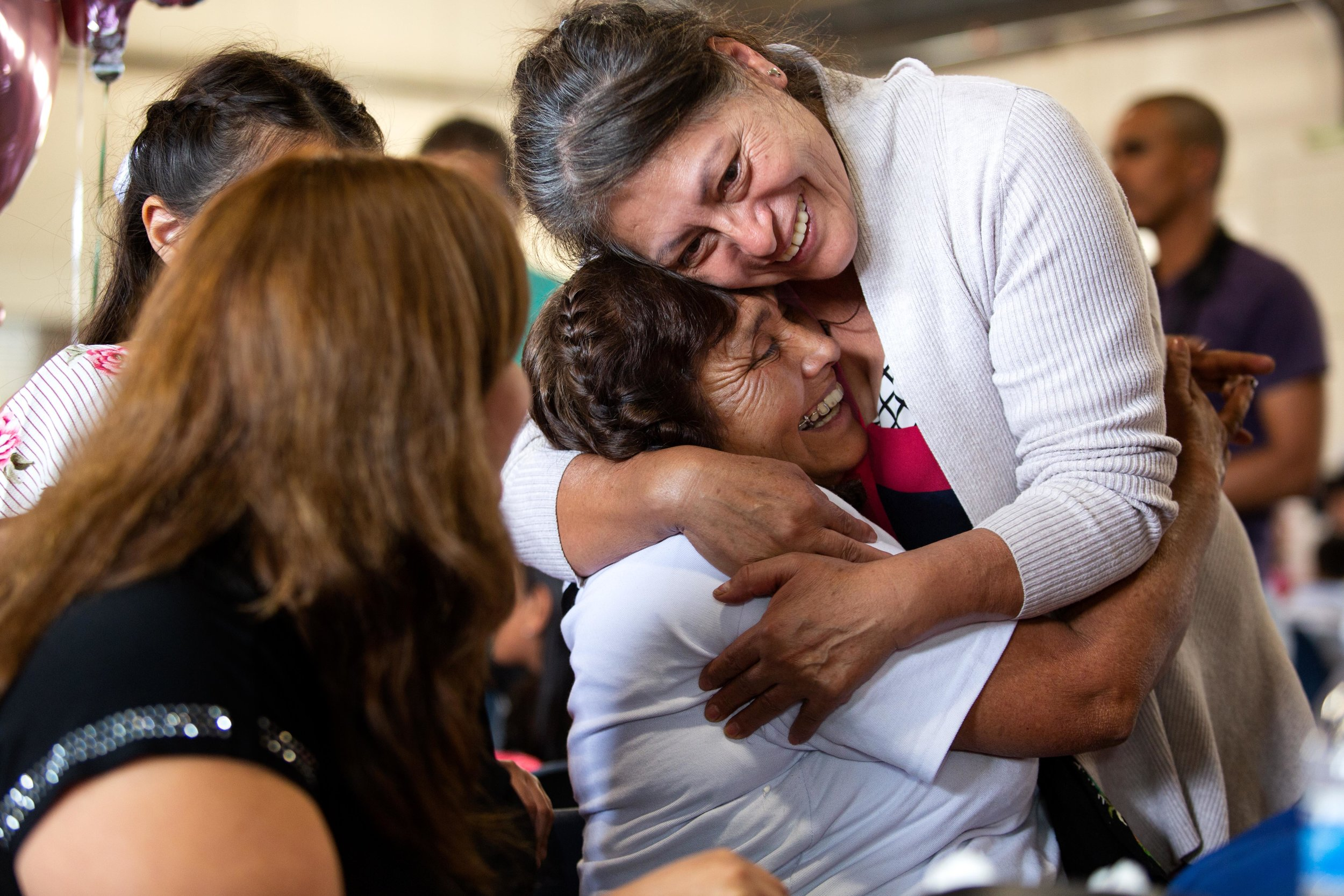 ROUND ROCK, TX. August 10, 2018. Rosa Barriga Barriga hugs her friend Delia Barriga after traveling from the Mexican State of Michoacán to be reunited with family members she has not seen in over a decade. Montinique Monroe for KUT News