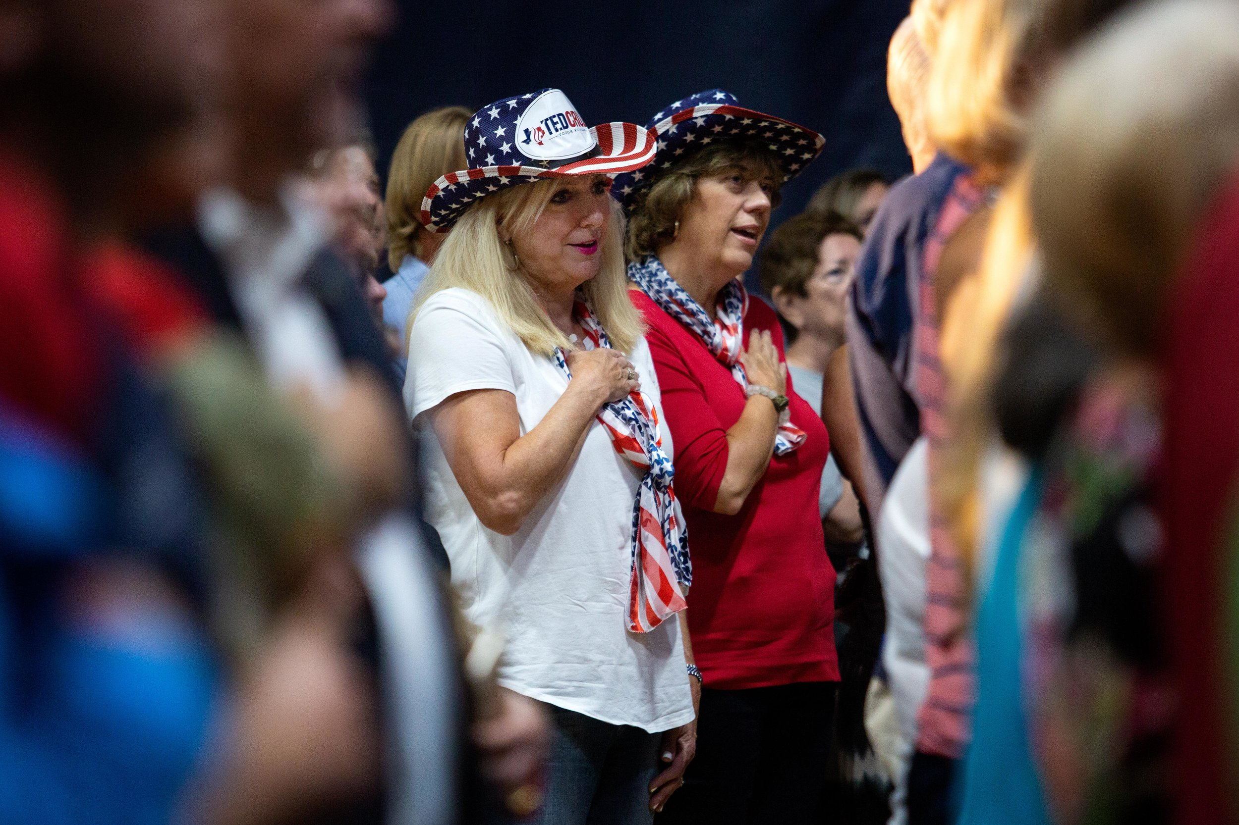 AUSTIN, TX. Sept. 8, 2018. Jennifer Kruse (left) and Linda Knox (right) sing the national anthem during a campaign rally for U.S. Sen. Ted Cruz in Katy, Texas. Montinique Monroe for KUT News
