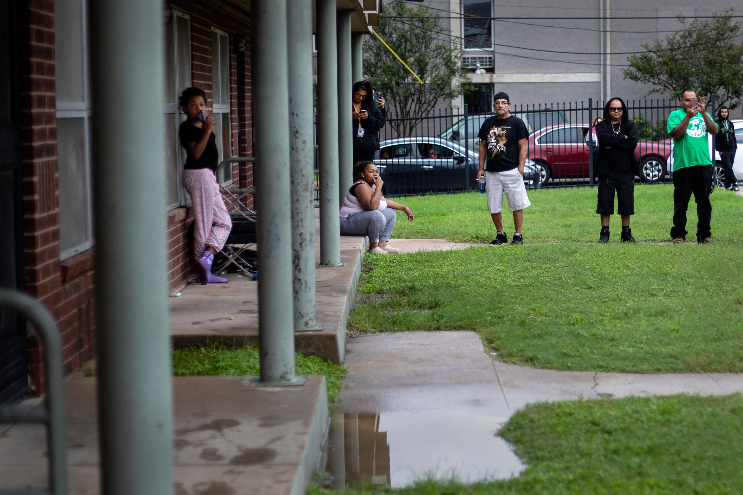 Residents watch an Austin Police Department SWAT team response to Booker T. Washington Terrace apartments on Oct. 19, 2018.