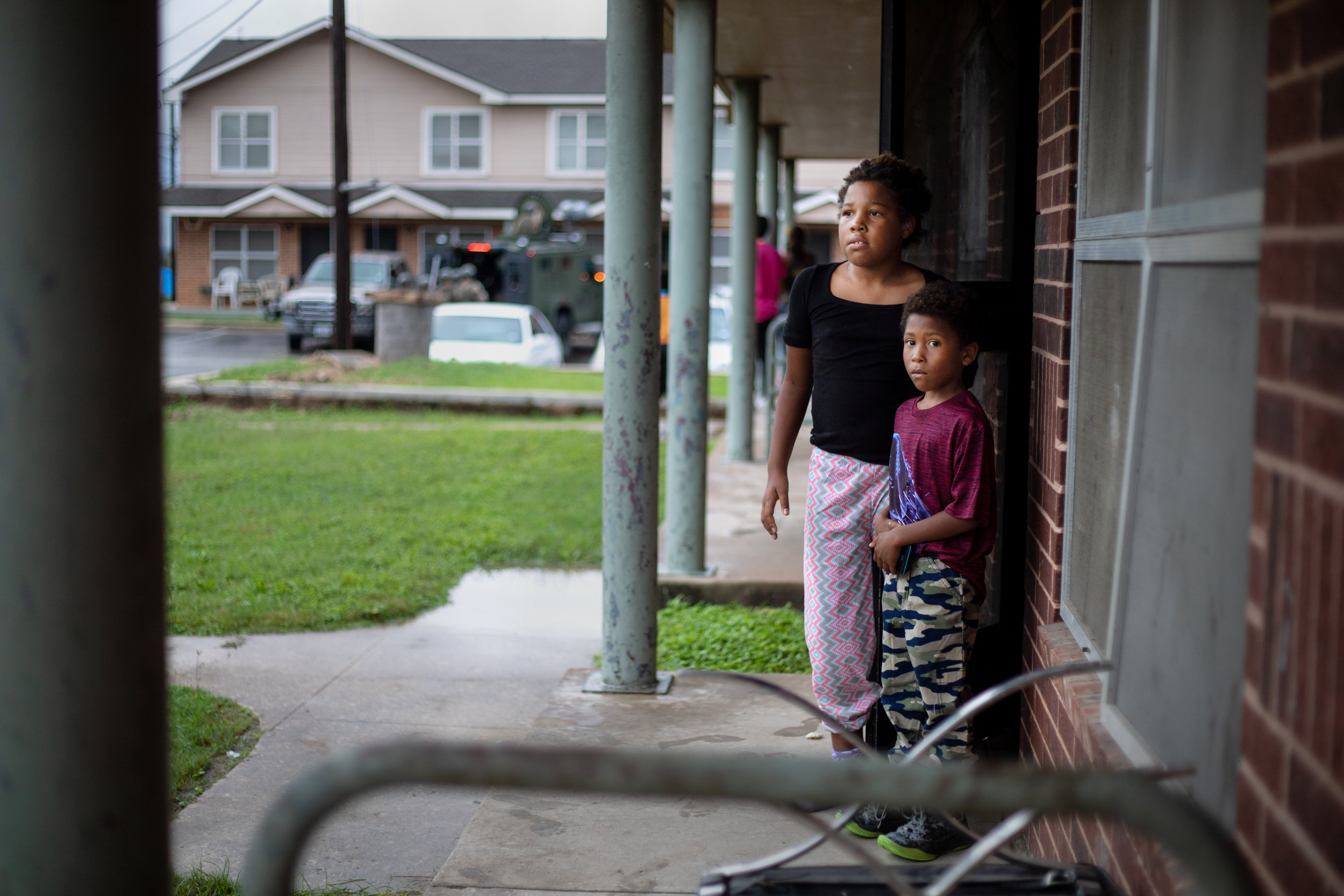 Trevina Tubbs-Tubbs, 9, and her brother Frederick Moreno -Tubbs III, 6, watch an Austin Police Department SWAT team response to Booker T. Washington Terrace apartments on Oct. 19, 2018.