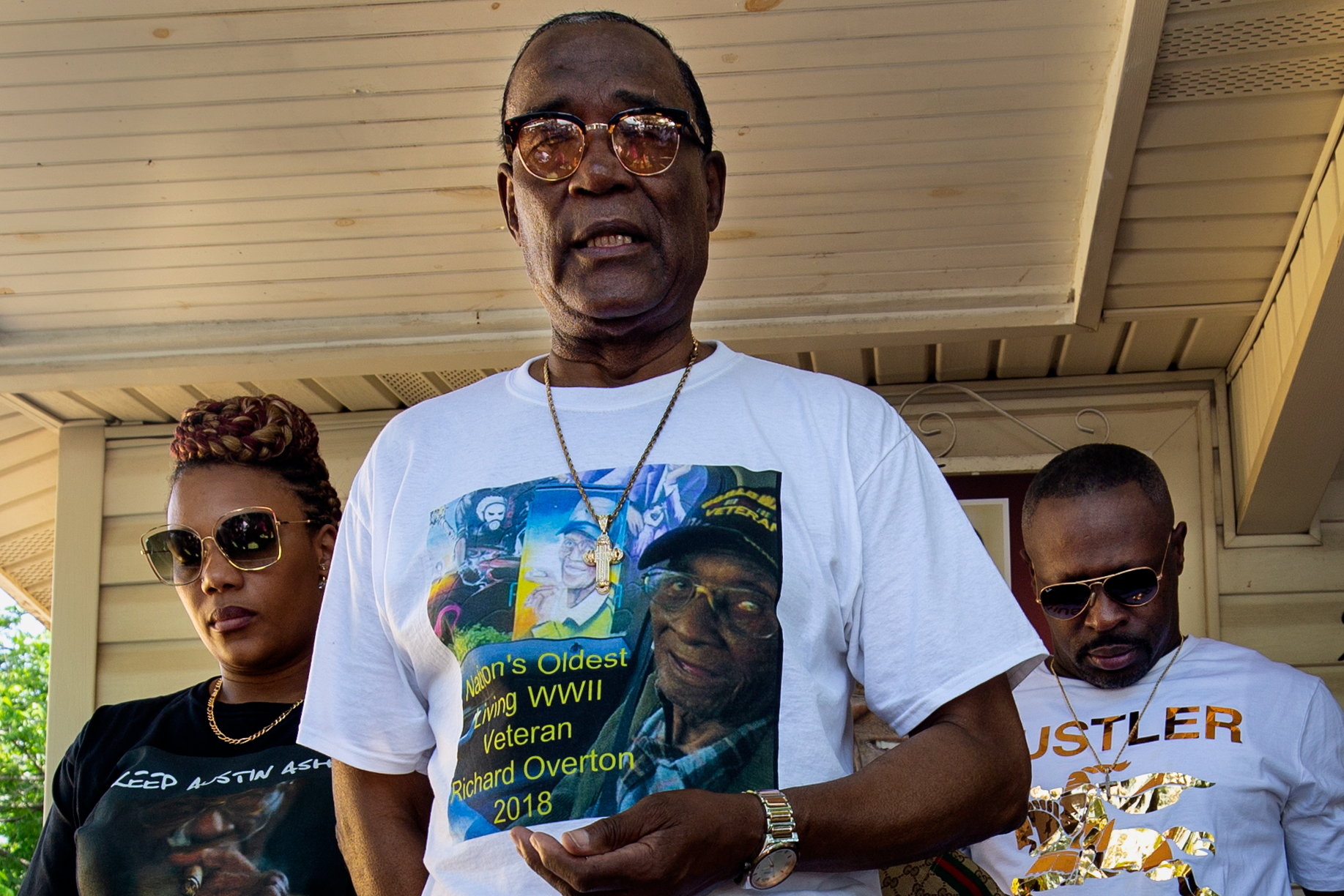 AUSTIN, TEXAS. May 11, 2018. Family members lead a prayer before beginning a celebration honoring Richard Overton, America's oldest living WWII veteran, for his 112th birthday. Montinique Monroe for KUT News