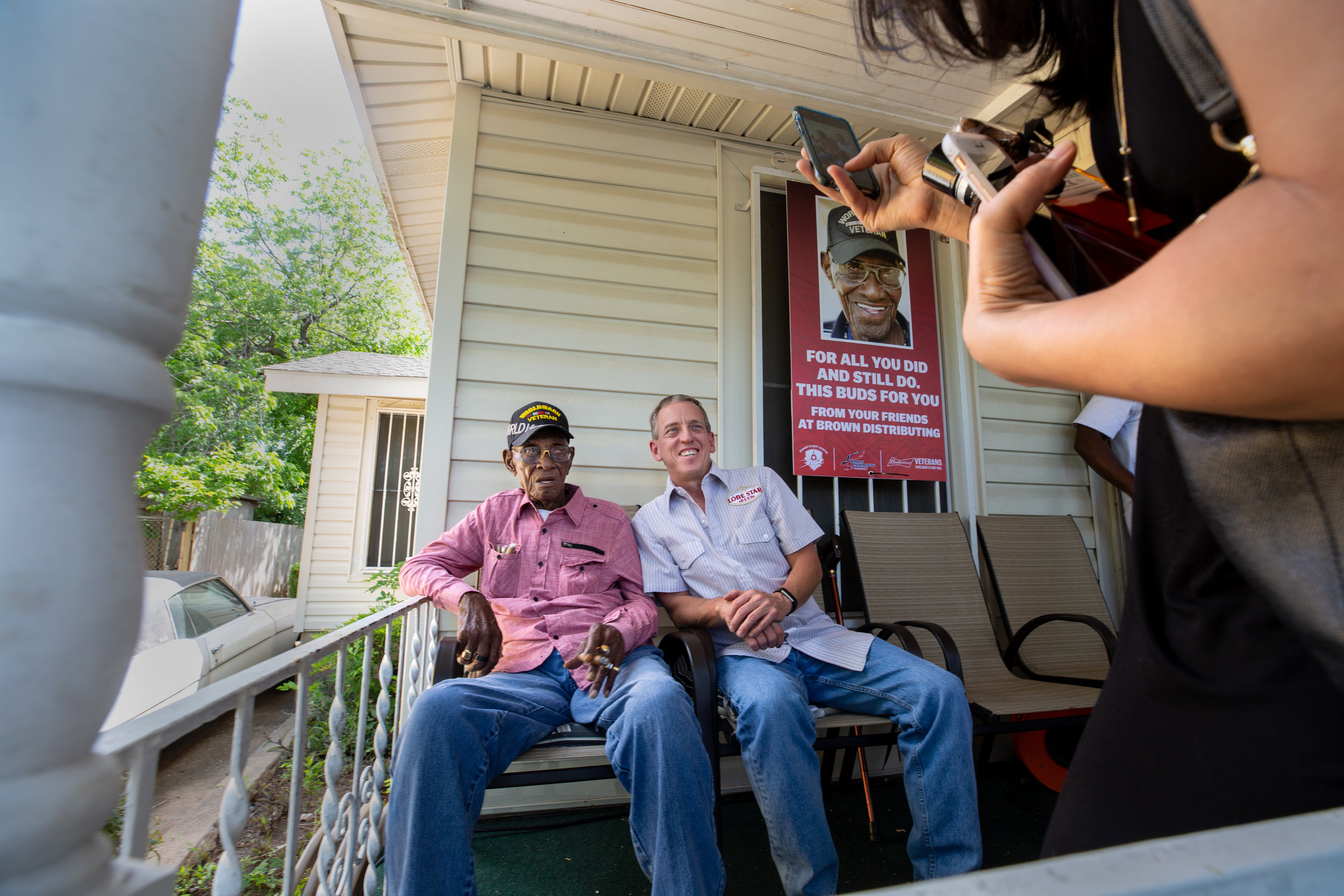 AUSTIN, TEXAS. May 11, 2018. Richard Overton poses for a photo on the front porch of his East Austin home during a public party celebrating his 112th birthday. Montinique Monroe for KUT News