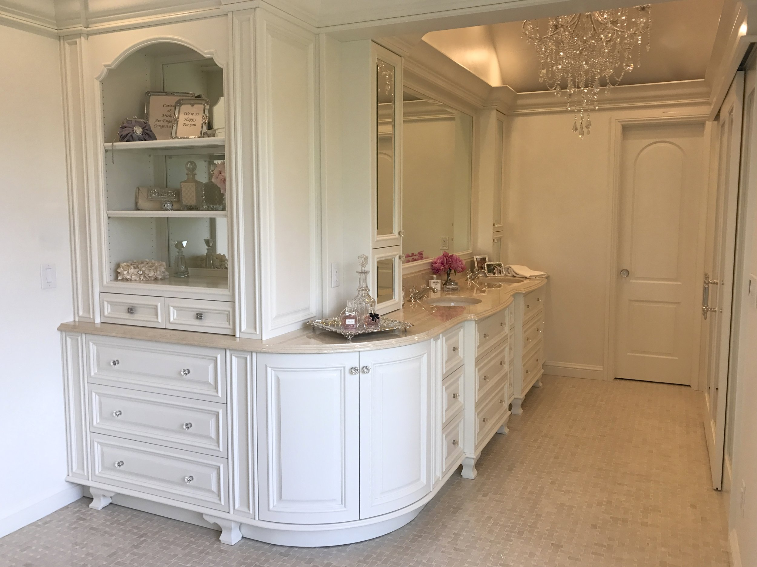 This rounded cabinet used to be a drywall corner which blocked  the light from the windows.  By removing this rounded wall cabinet storage, countertop space and light were all gained. In the before below you can see that a linen closet was also replaced with cabinetry opening up the space.