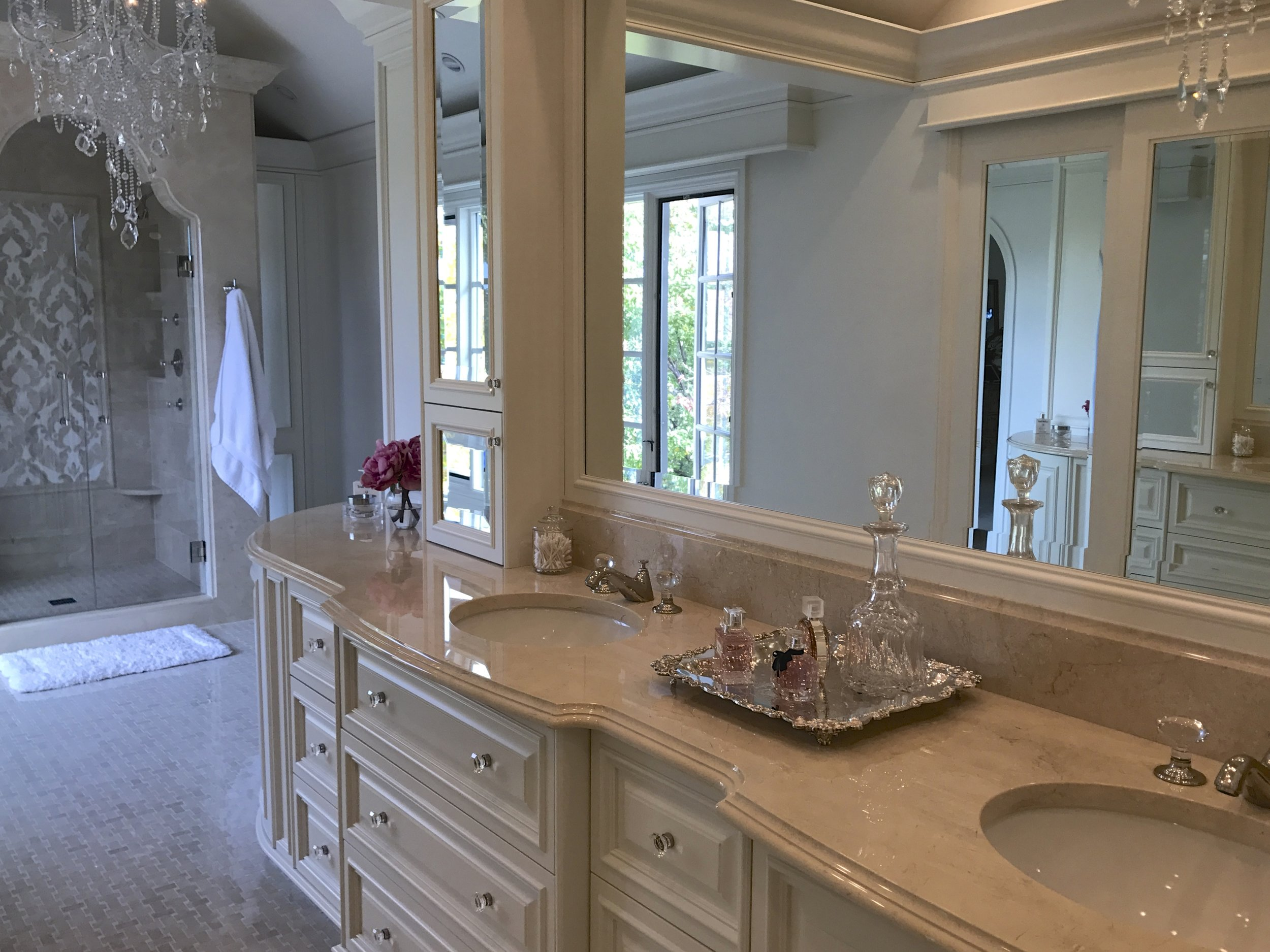 The above countertop cabinet is deeper than it appears.  It is recessed behind the mirror.  Inside is ample storage with electrical plugs for appliances that pull out.