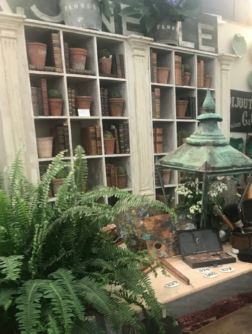 Antique book and rustic pots are a such a beautiful way to decorate a bookcase.  We'll have both books and french terra cotta pots at Objet Trouvé.
