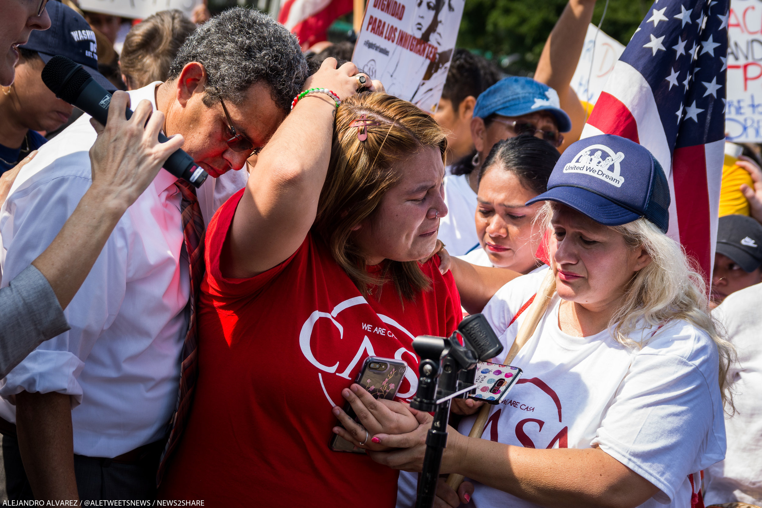 Dreamers react to news of Trump's planned cancellation of DACA at a White House protest on Tuesday.