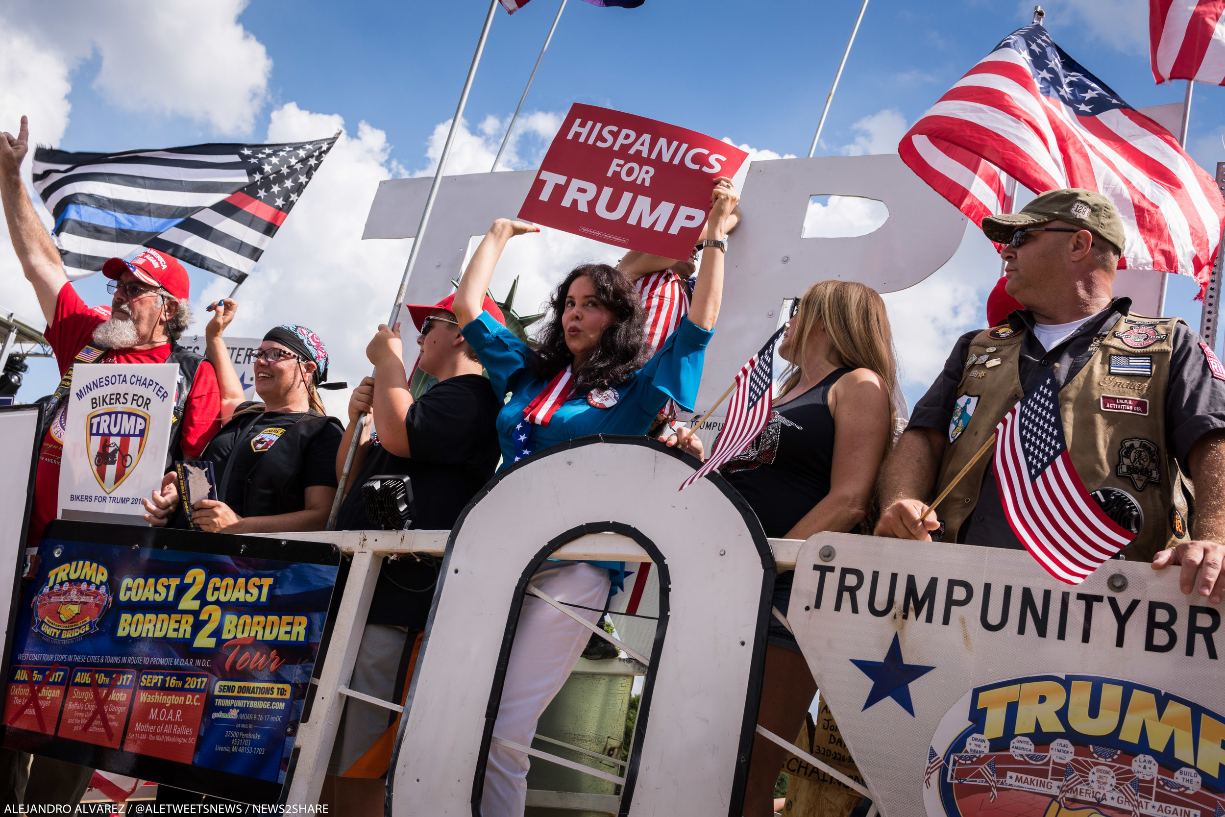 """Supporters sing """"God Bless America"""" atop the Trump """"unity bridge"""" greeted rally-goers on the National Mall."""