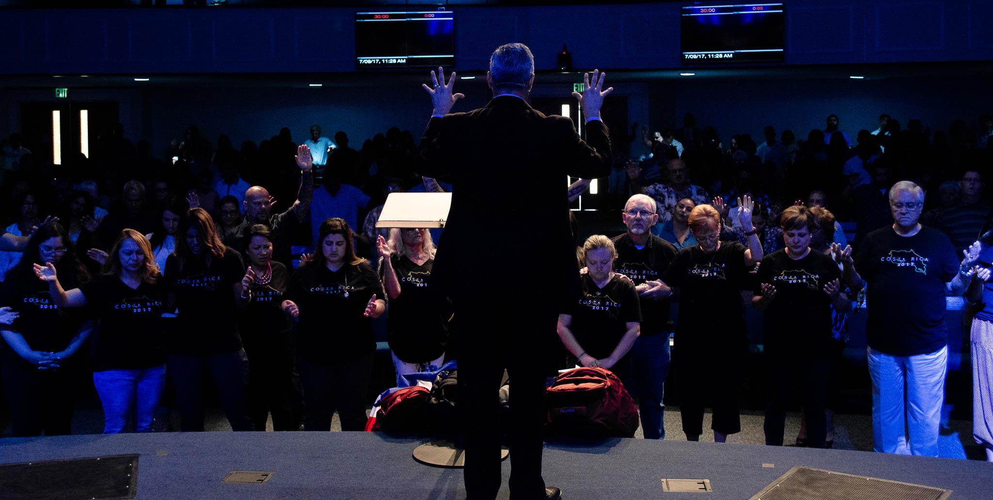 Pastor_praying_for_people_at_altar