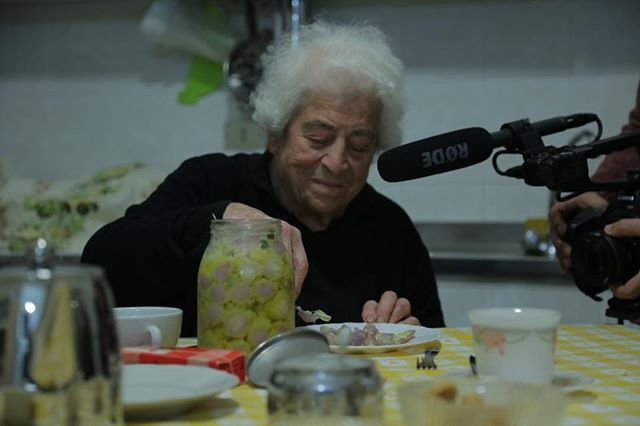 Best of the Fest Encore screening today #thegoldenharvestfilm at #mspiff38 @4.50 pm at St. Antony Main —thank you #mspiff sponsors  and audience!  And thank you to the beautiful woman in the photo —we filmed her in #puglia —Enzo's mama.  Sign that the in the jar is good : it hardened in the fridge.  What's in the jar besides olive oil is for you to guess. . . . #spain #italy #salento #greece #palestine #umnproud #documentary #oliveoil