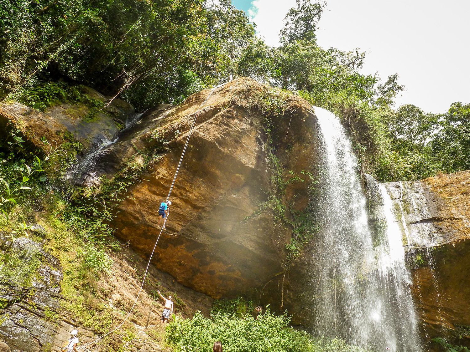 Hikers rappel off a waterfall in Costa Rica.Photo by Stacey McKenna.
