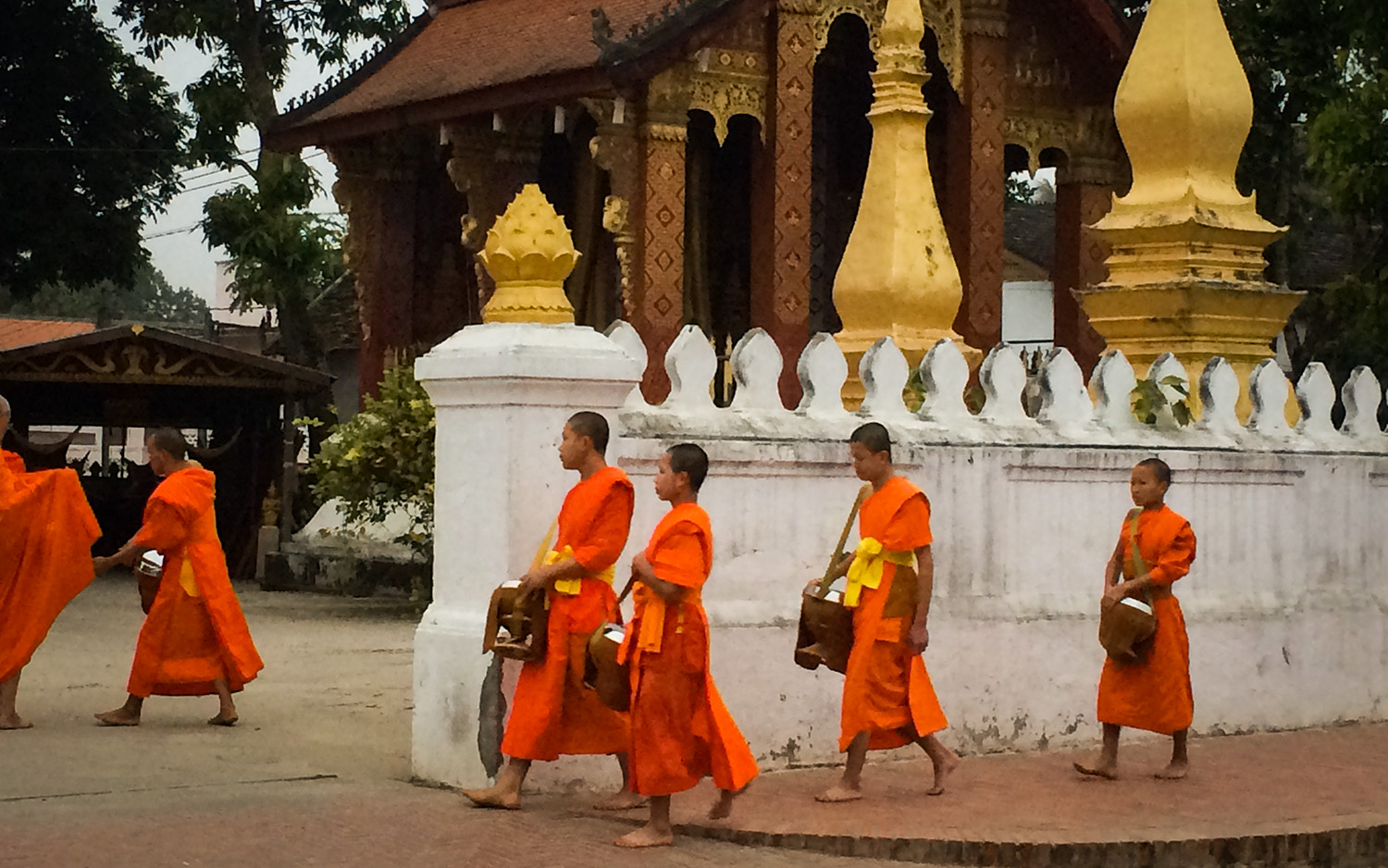 Monks returning to their temple after the tak bat. Photo by Johanna Read TravelEater.net