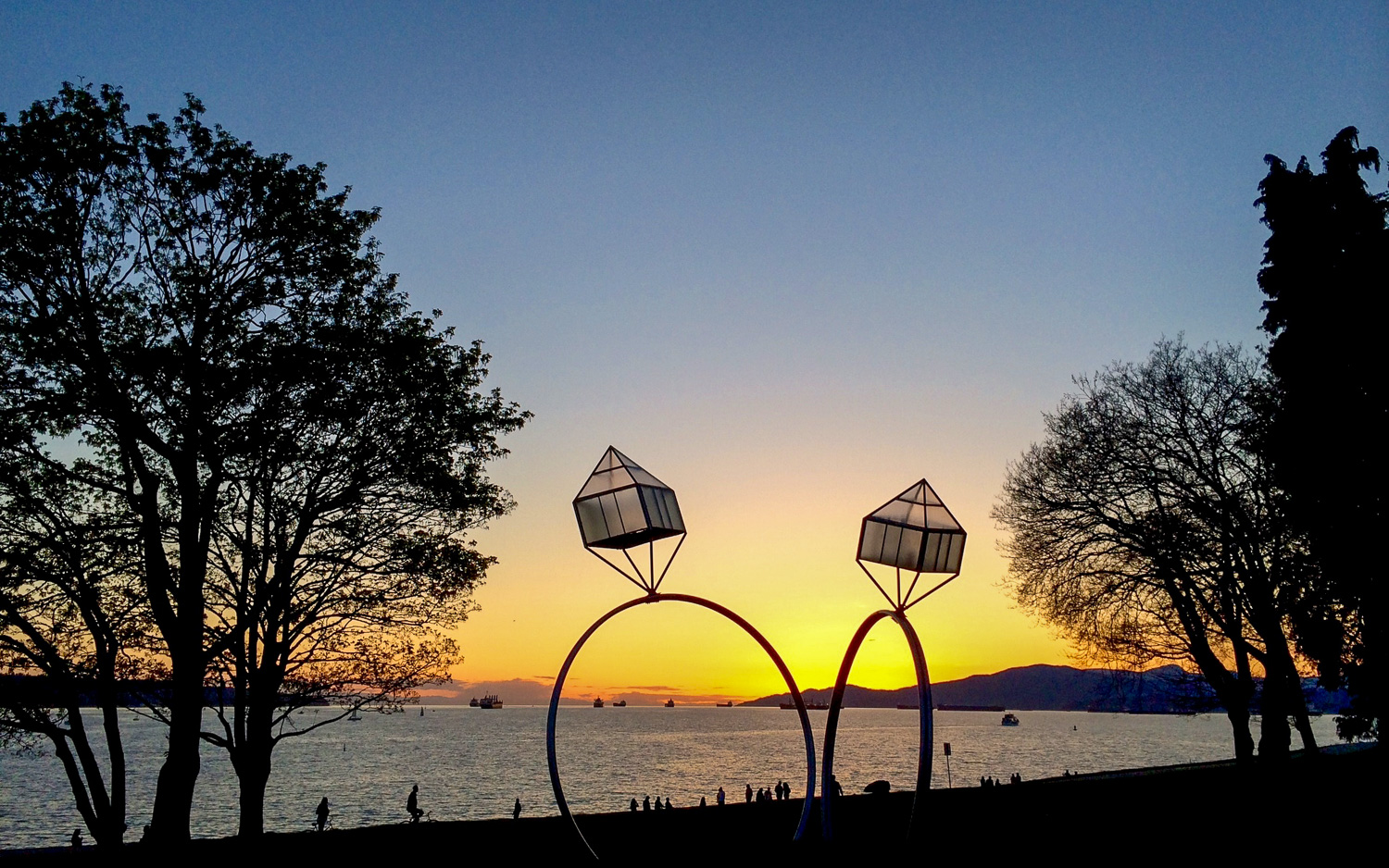 A romantic sunset along the sea wall at Sunset Beach, looking out toward English Bay. Photo by Johanna Read TravelEater.net.