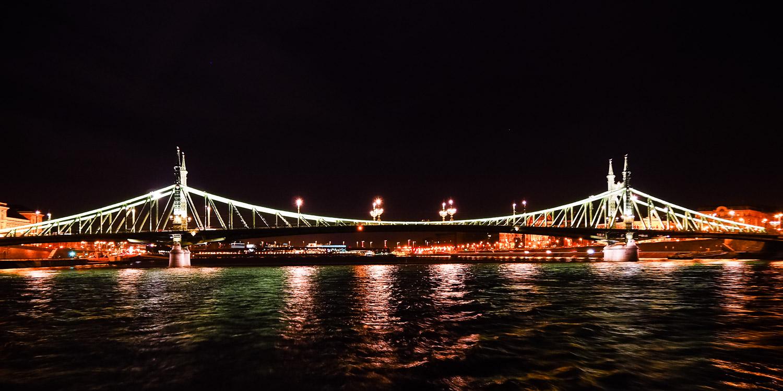 Szabadság Bridge at night - Wayward Weekend Budapest