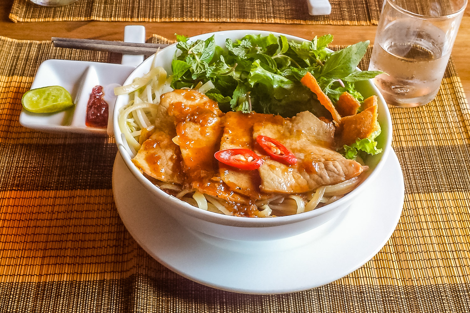 """Cao Lầu """"Traditional Hoi An Specialty Noodles with Pork, Fresh Herbs and Crispy Croutons in Natural Juices"""""""
