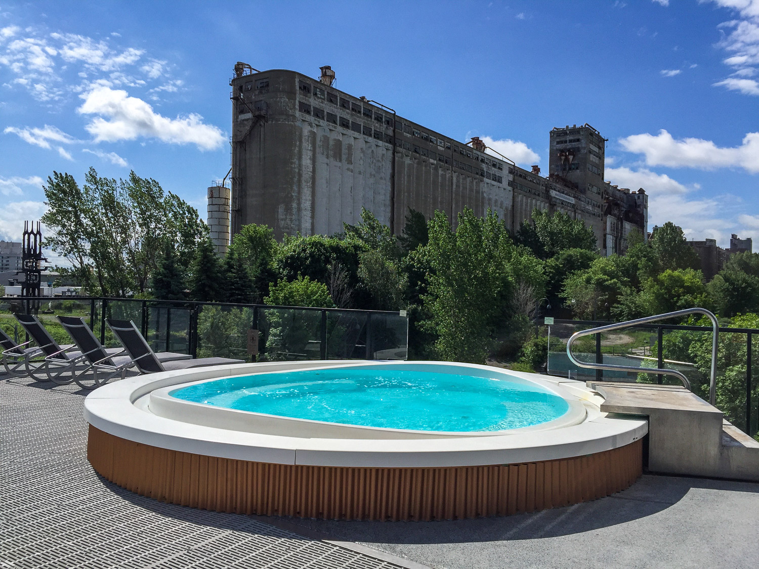 Hot tub with a view of the industrial port's past at Bota-Bota spa. Credit C Laroye - A Wayward Weekend in Montréal
