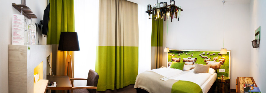 Room in the green hotel in Vienna. Photo: Boutiquehotel Stadthalle Vienna.