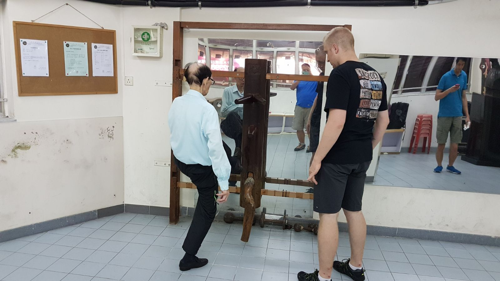 Robert Ley Being taught on the Wooden Dummy by his Sifu, Roland Tong