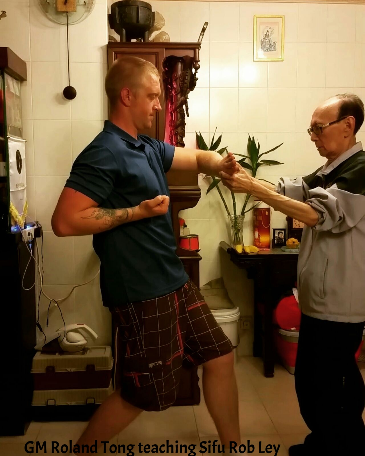 Robert Ley during some training with his Sifu GM Roland Tong