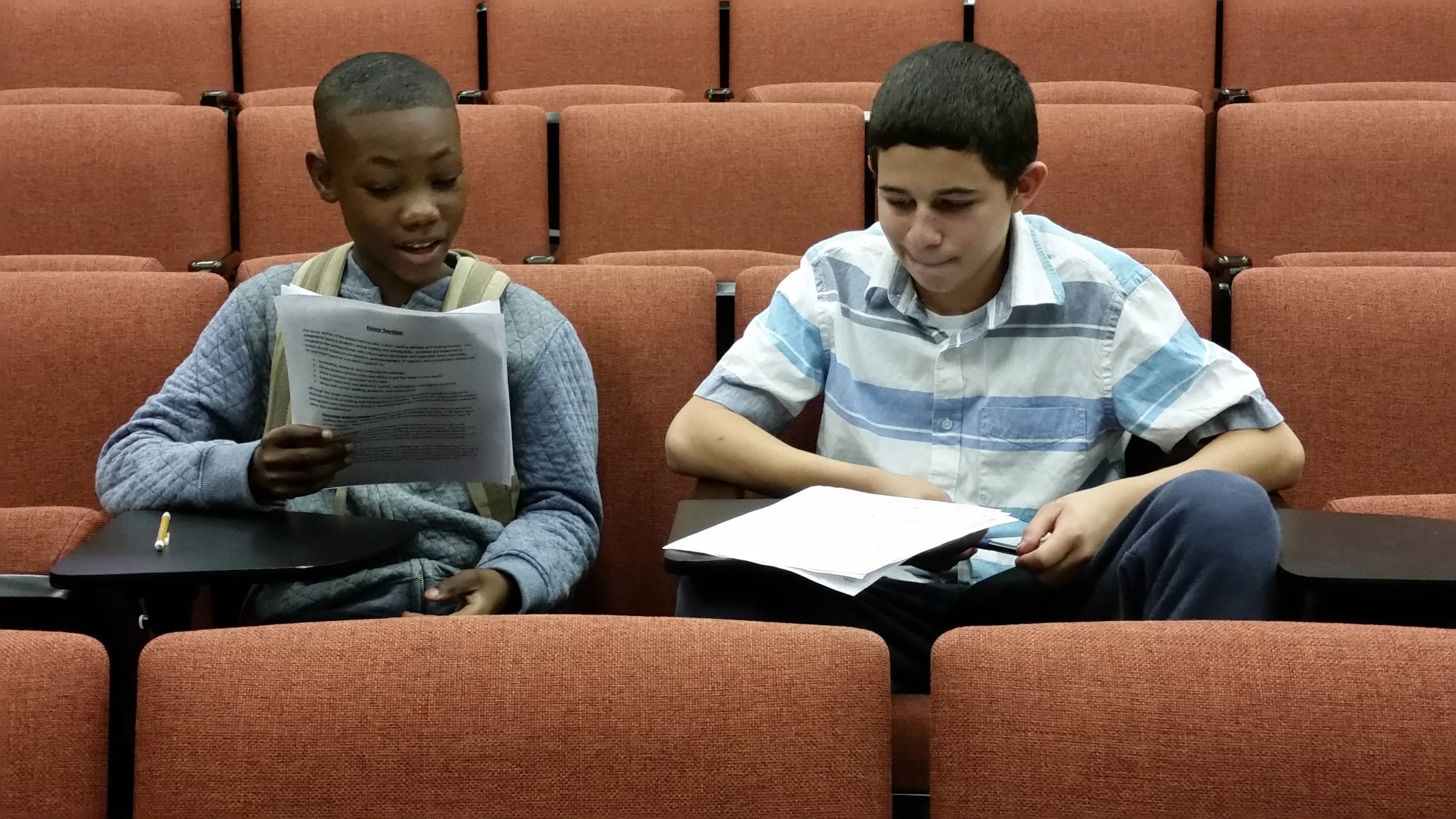 BEAM boys write essays to prepare for high school