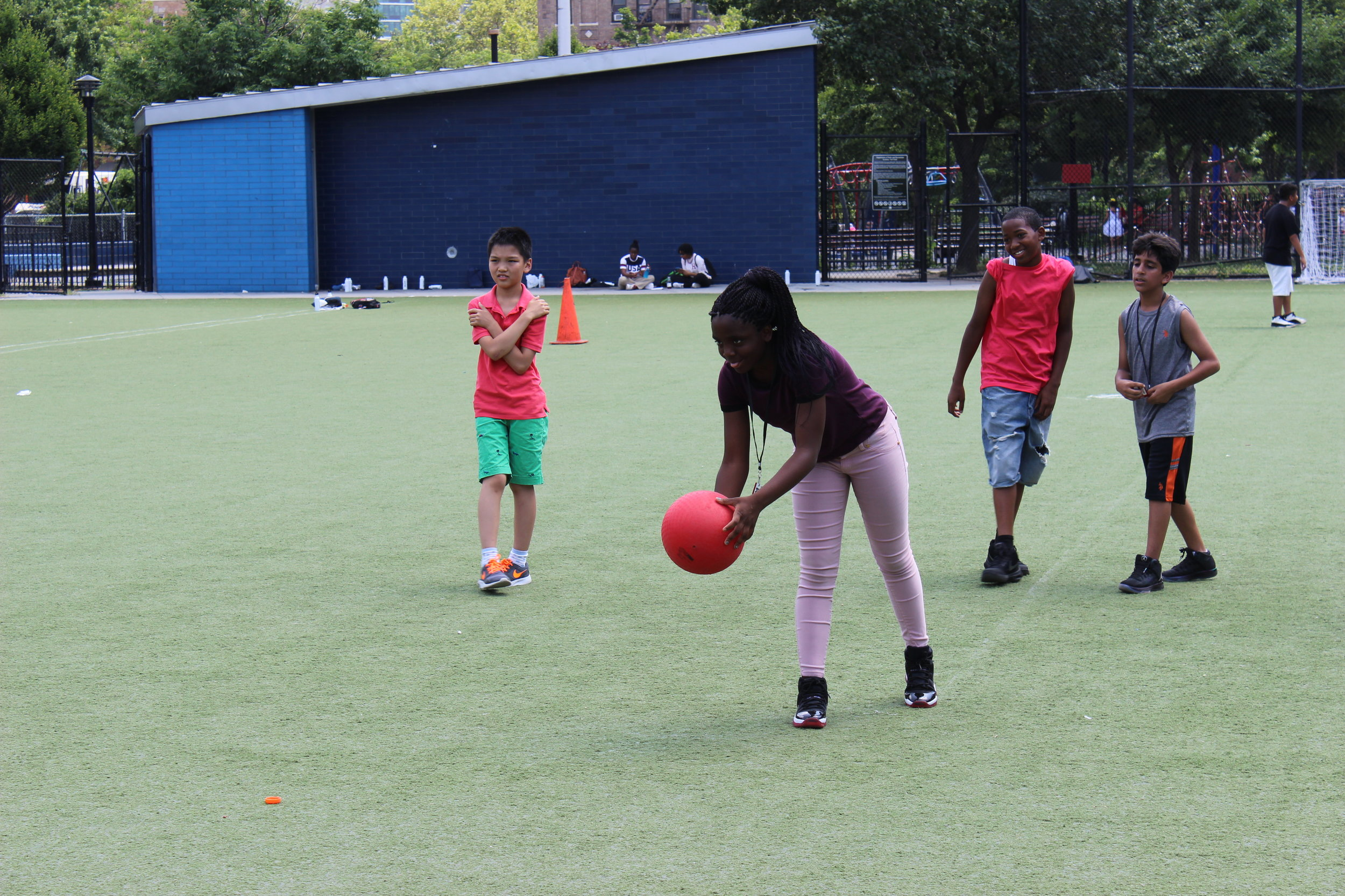 Jason, Brianna, Messiah, and Mohammad are enjoying an exciting game of Kickball.