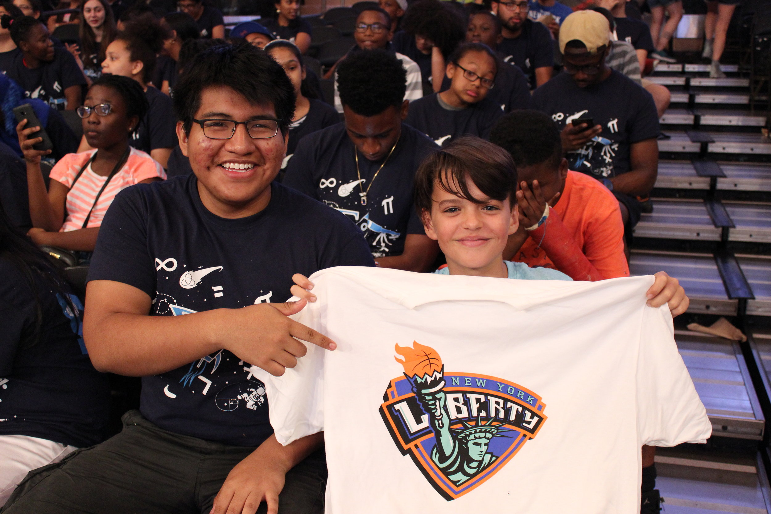 Junior Counselor Lennin and Eils pose for a photo with a NY Liberty T-shirt.